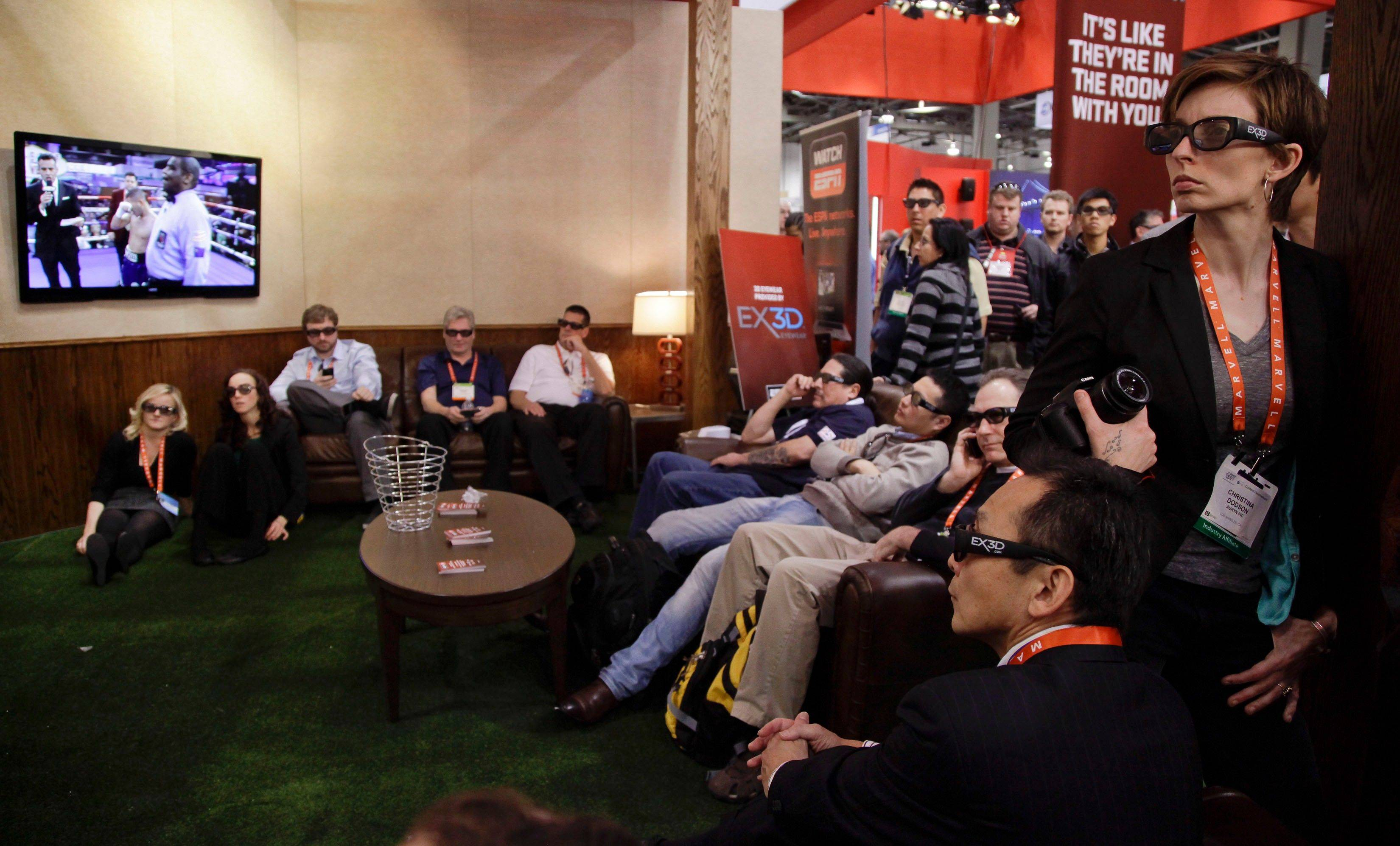Industry affiliates and buyers gather to watch a live ESPN broadcast of boxing in 3-D at the 2012 International Consumer Electronics Show.