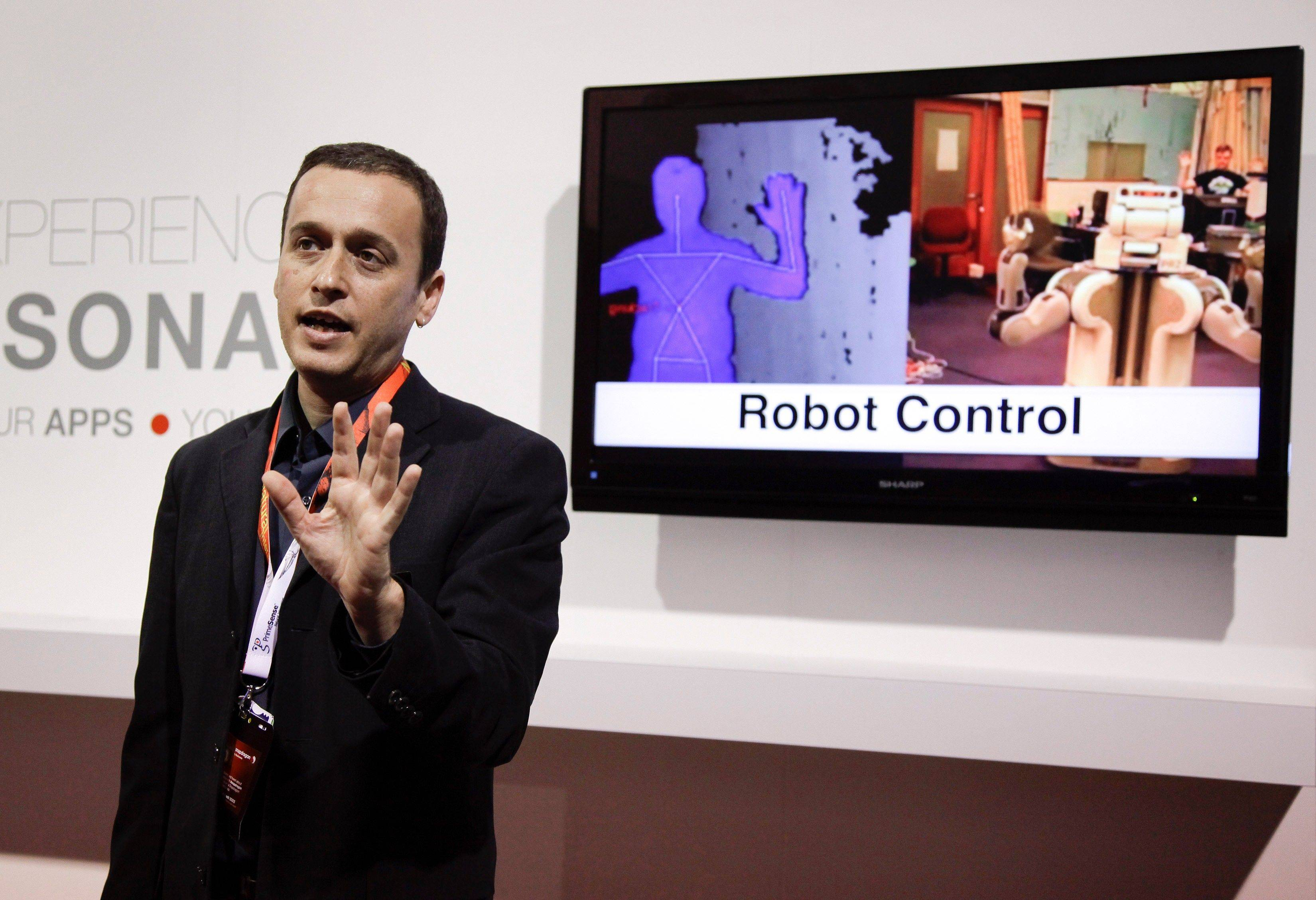 PrimeSense employee Adi Berenson demonstrates the use of depth control cameras at the 2012 International Consumer Electronics Show in Las Vegas. The technology allows control of electronic devices with body motion.