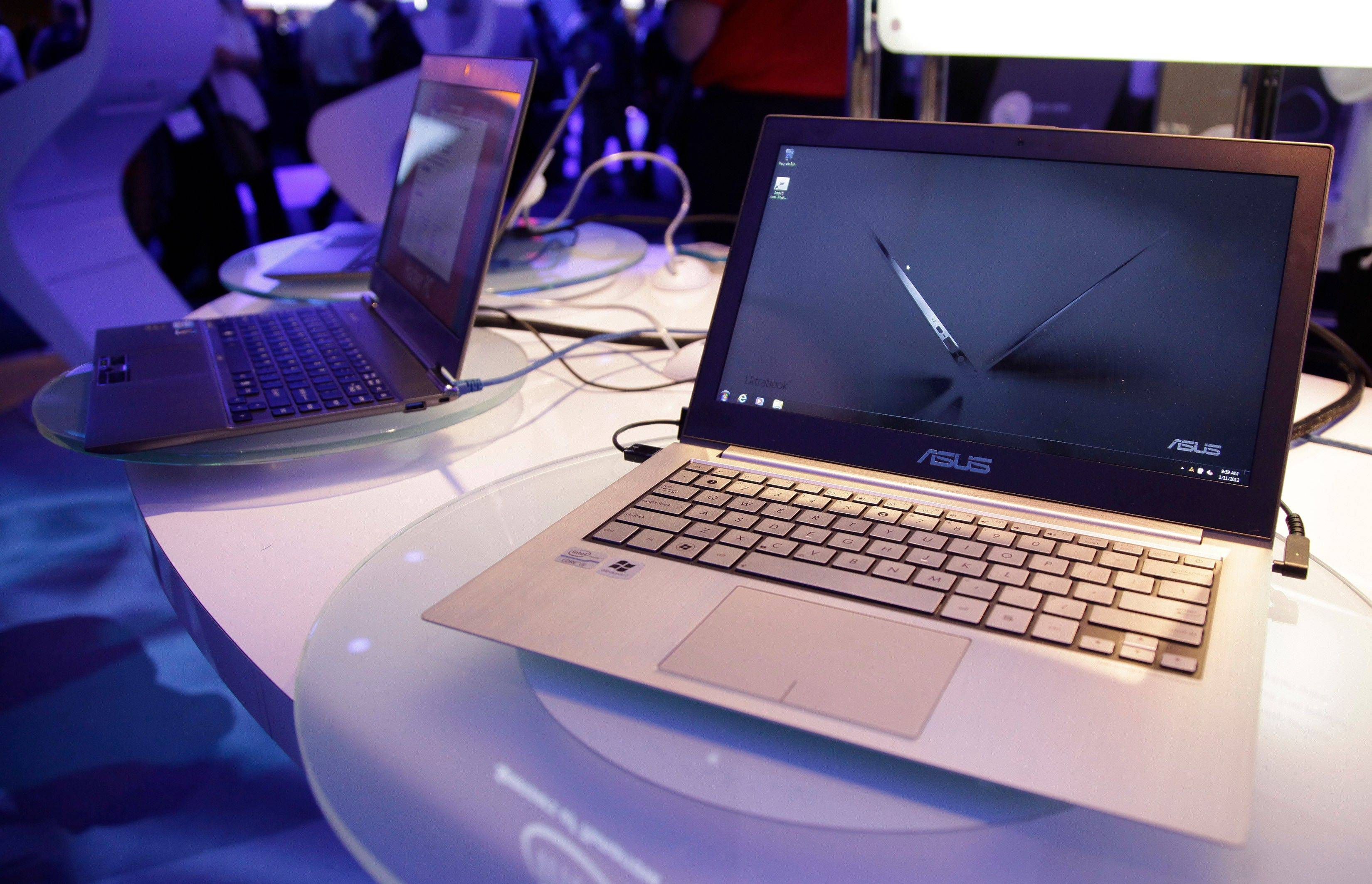 Ultrabooks sit on display at the Intel exhibit at the 2012 International CES trade show, in Las Vegas.
