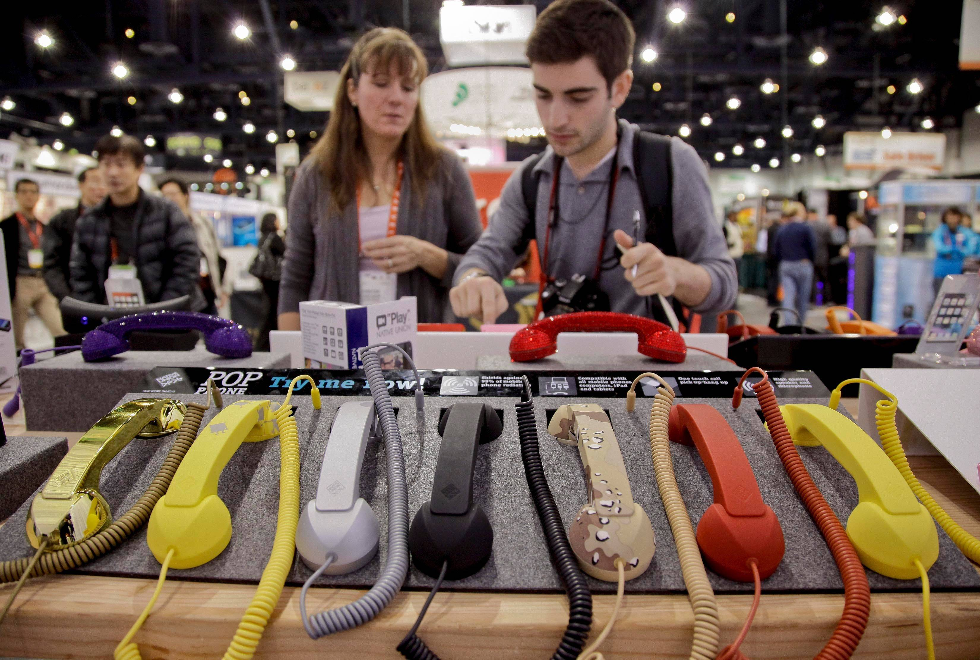 Cell phone hand sets are seen on display at the 2012 International Consumer Electronics show.
