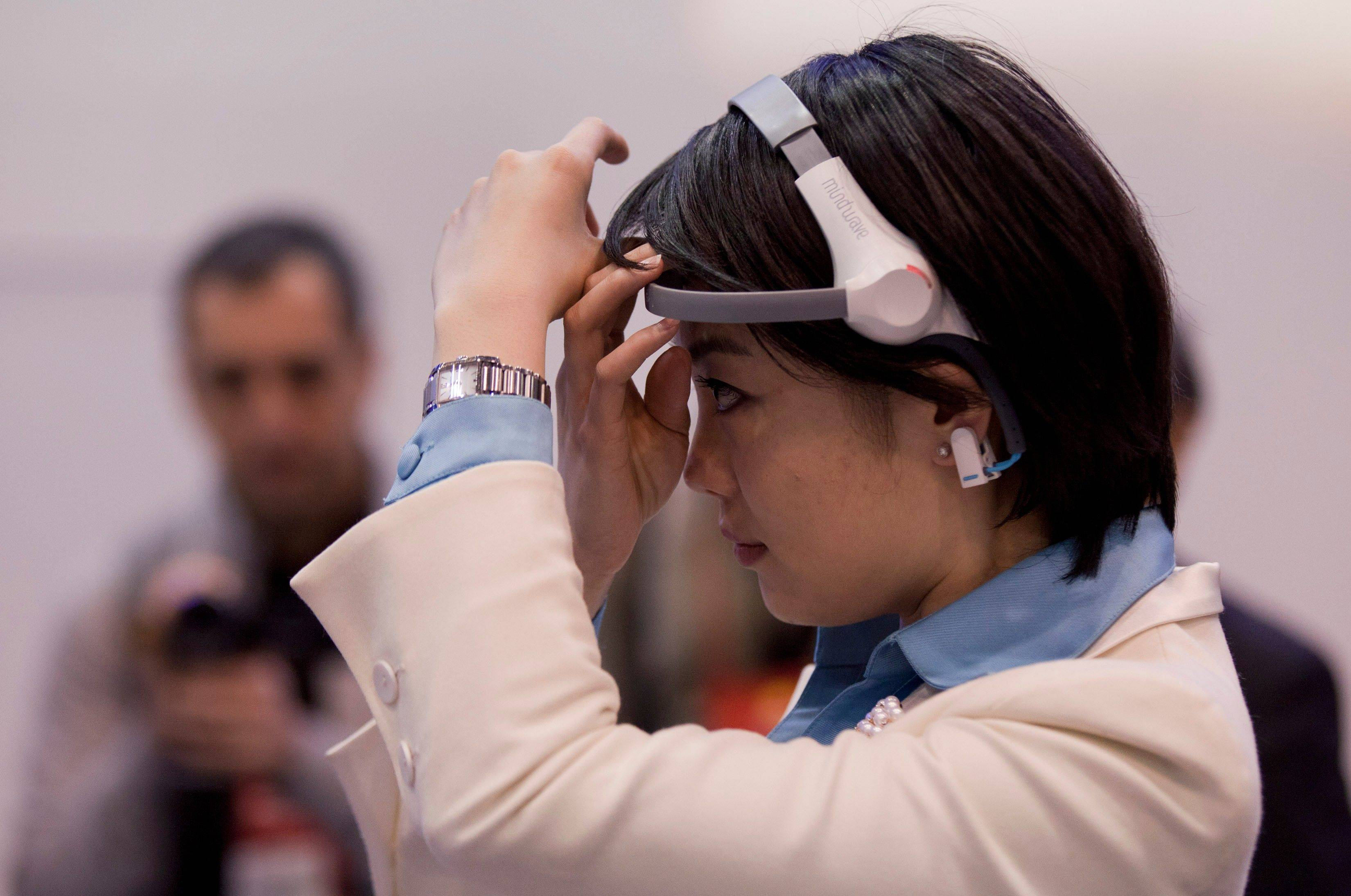 The Haier Brain Wave TV headset at the 2012 International Consumer Electronics show in Las Vegas. The headset, which measures brain waves with one sensor on the wearer�s forehead and another clipped onto an earlobe, can sense if the user wants something on a TV set to go up or down. Haier is selling the set in China, but has no plans to bring it to market in the U.S.