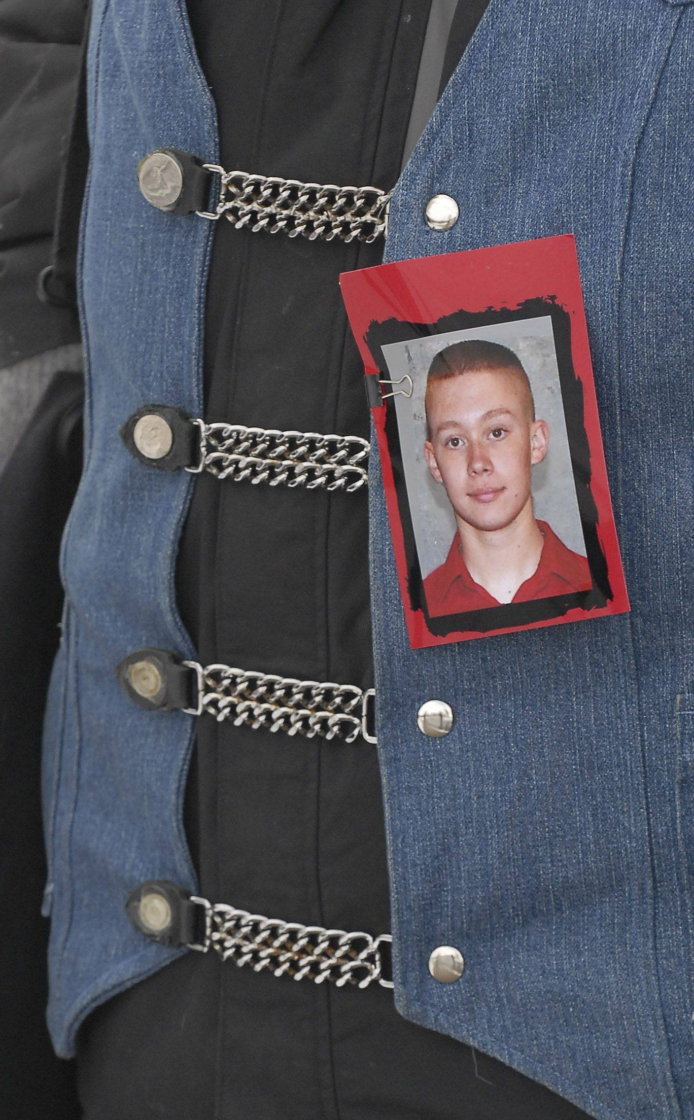 Photos of Spc. Christopher A. Patterson, a member of the 713th Engineer Company of the Indiana National Guard, were worn by members of the Patriot Guard at his funeral.