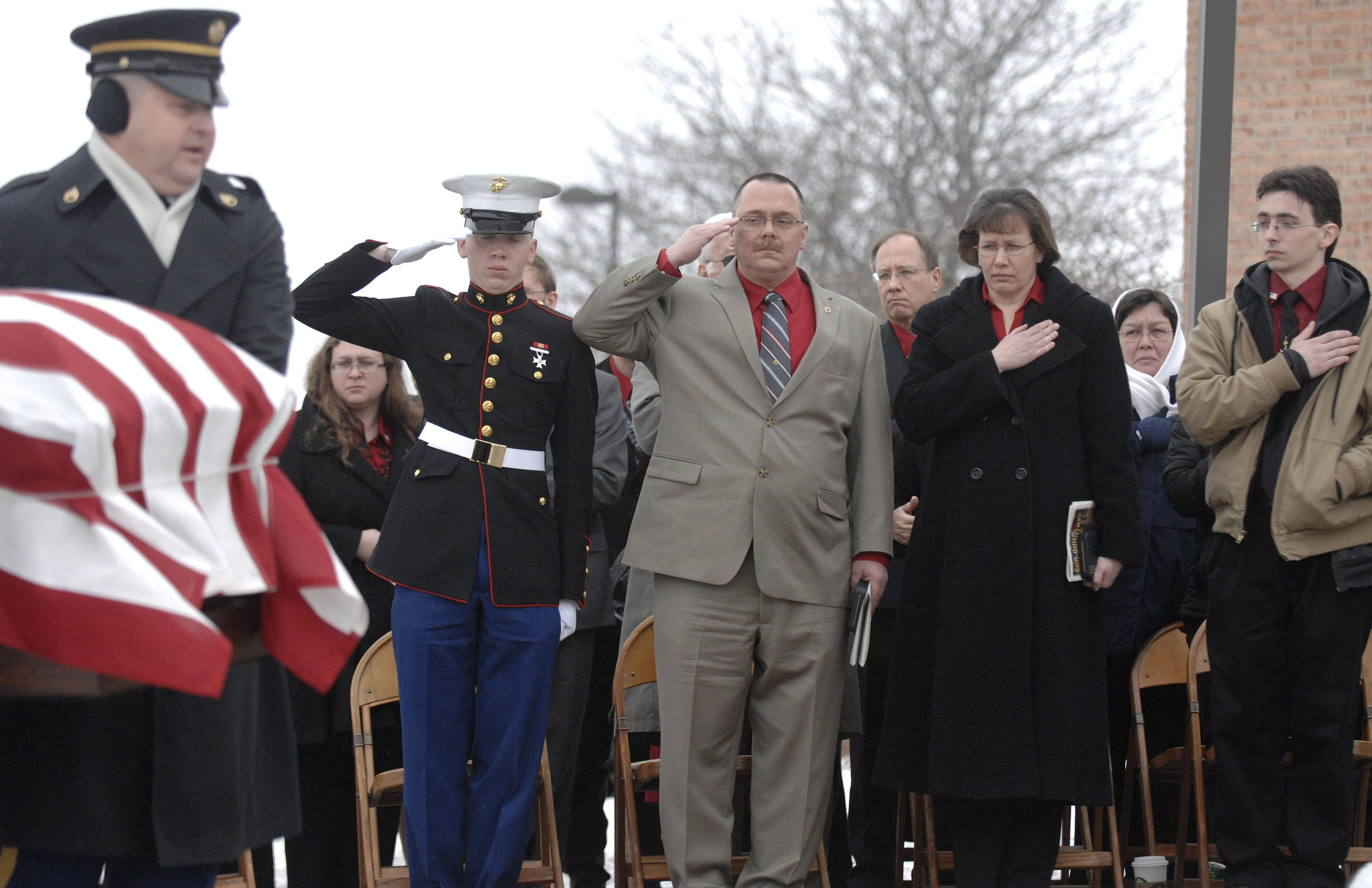 Bob and Mary Patterson, flanked by sons Carl, left, and Thomas pay their respects as the casket of their son, Spc. Christopher A. Patterson, is placed outside Immanuel Lutheran Church for full military honors at his funeral in Batavia on Saturday, January 21. Patterson was a member of the 713th Engineer Company of the Indiana National Guard and was from North Aurora.