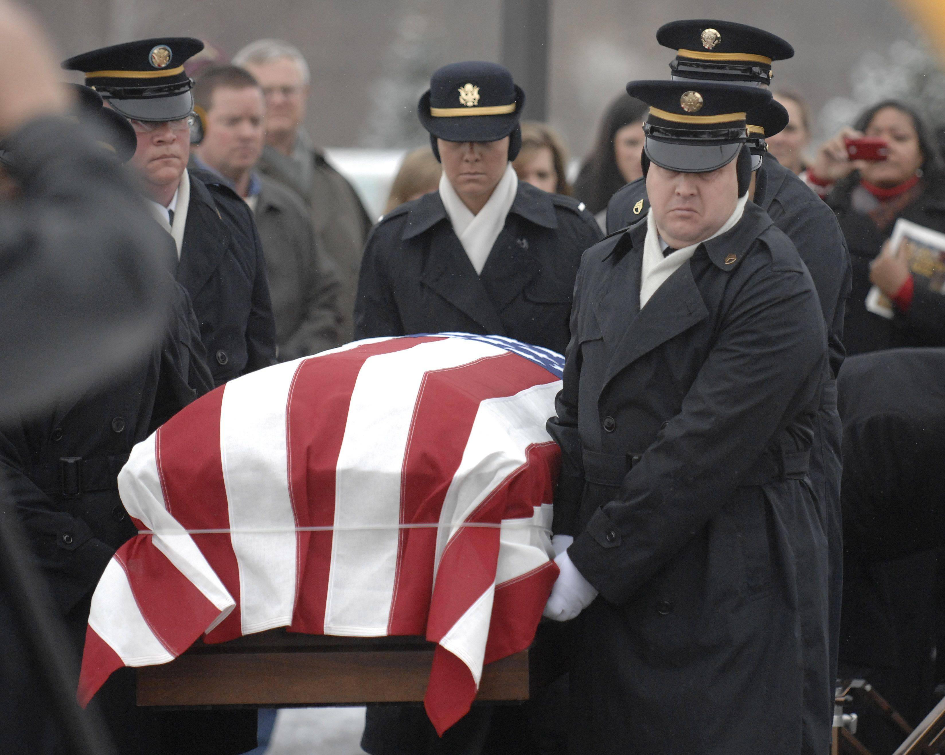 Staff Sergeant Jeffrey Hawley, left, leads the Indiana National Honor Guard Ceremonial Unit while bringing the casket of Spc. Christopher A. Patterson outside for full military honors after his funeral at Immanuel Lutheran Church in Batavia on Saturday, January 21.