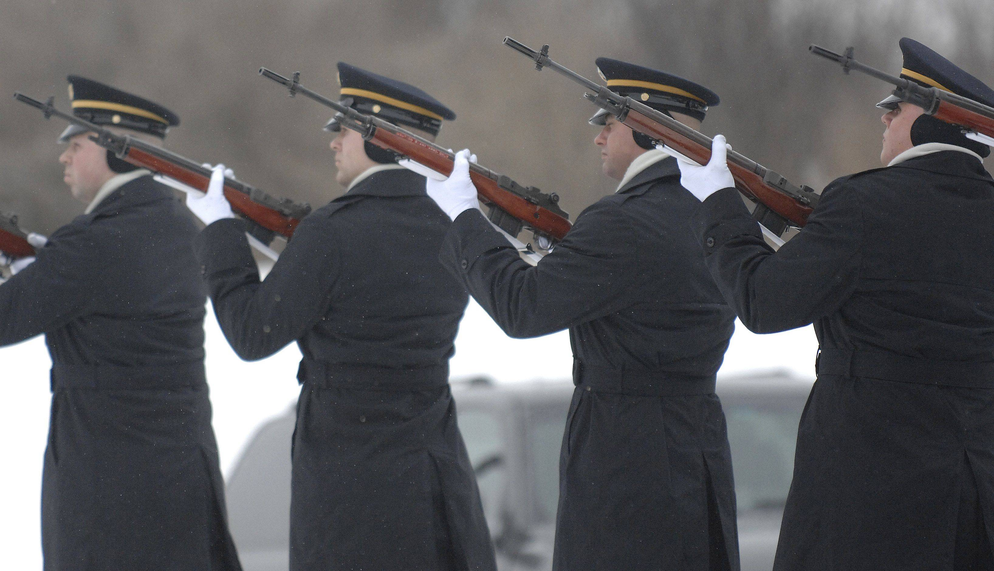 A 21-gun salute is fired for Spc. Christopher A. Patterson outside Immanuel Lutheran Church in Batavia on Saturday, January 21.
