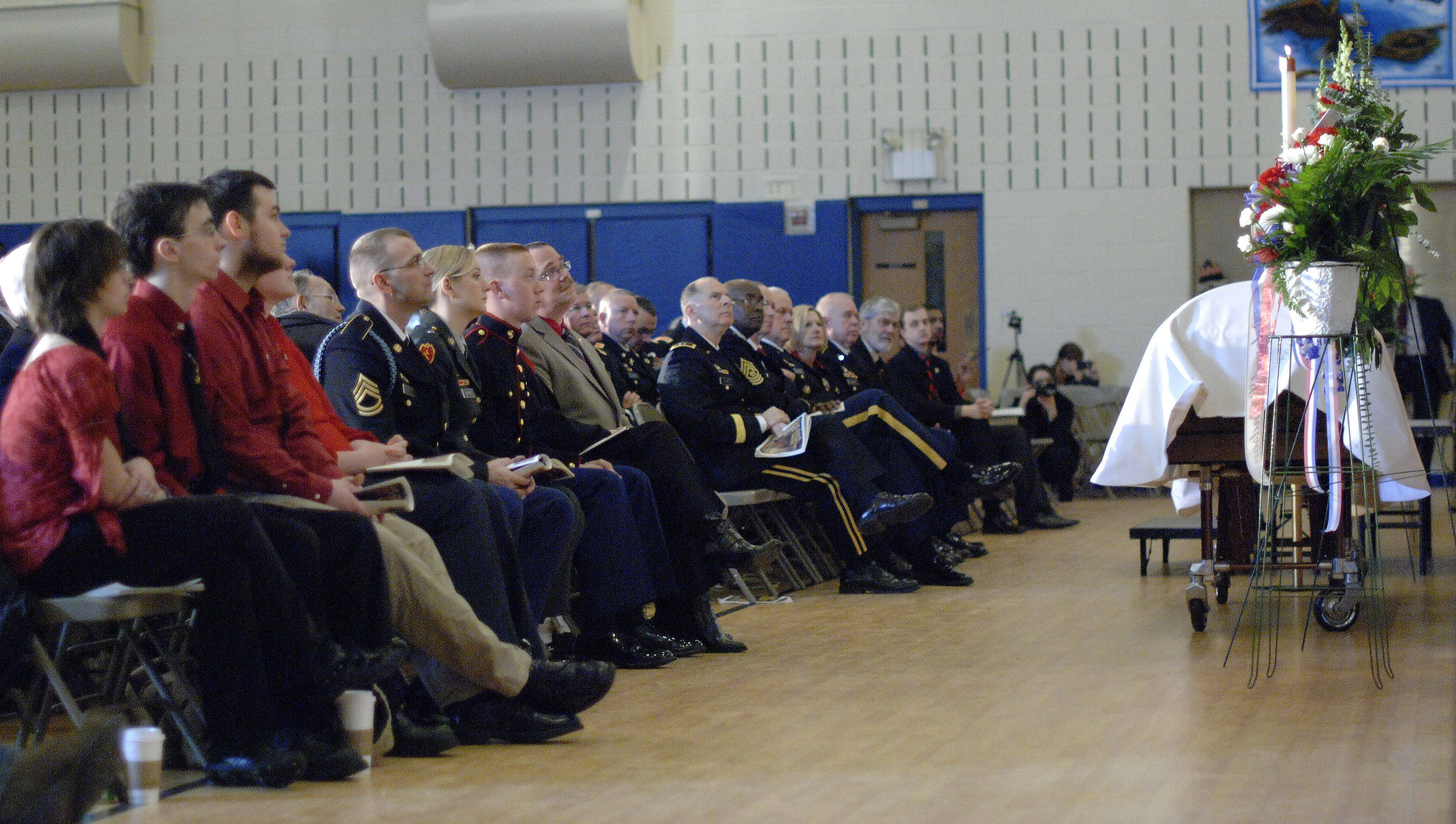 The casket of Spc. Christopher A. Patterson sits at the front of the auditorium at Immanuel Lutheran Church in Batavia on Saturday, January 21.