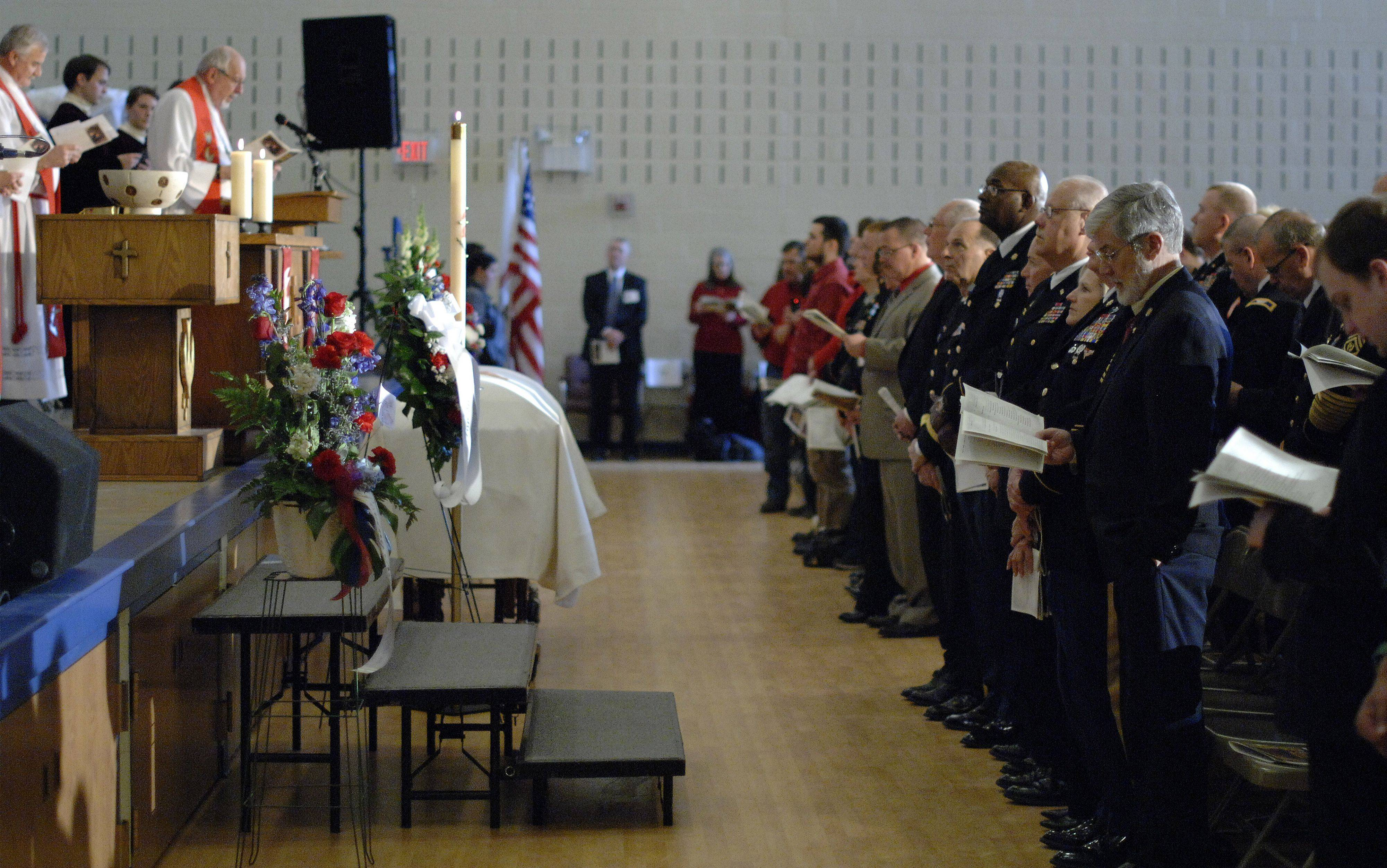The casket of Spc. Christopher A. Patterson, a member of the 713th Engineer Company of the Indiana National Guard, sits at the front of the auditorium at Immanuel Lutheran Church in Batavia on Saturday, January 21.