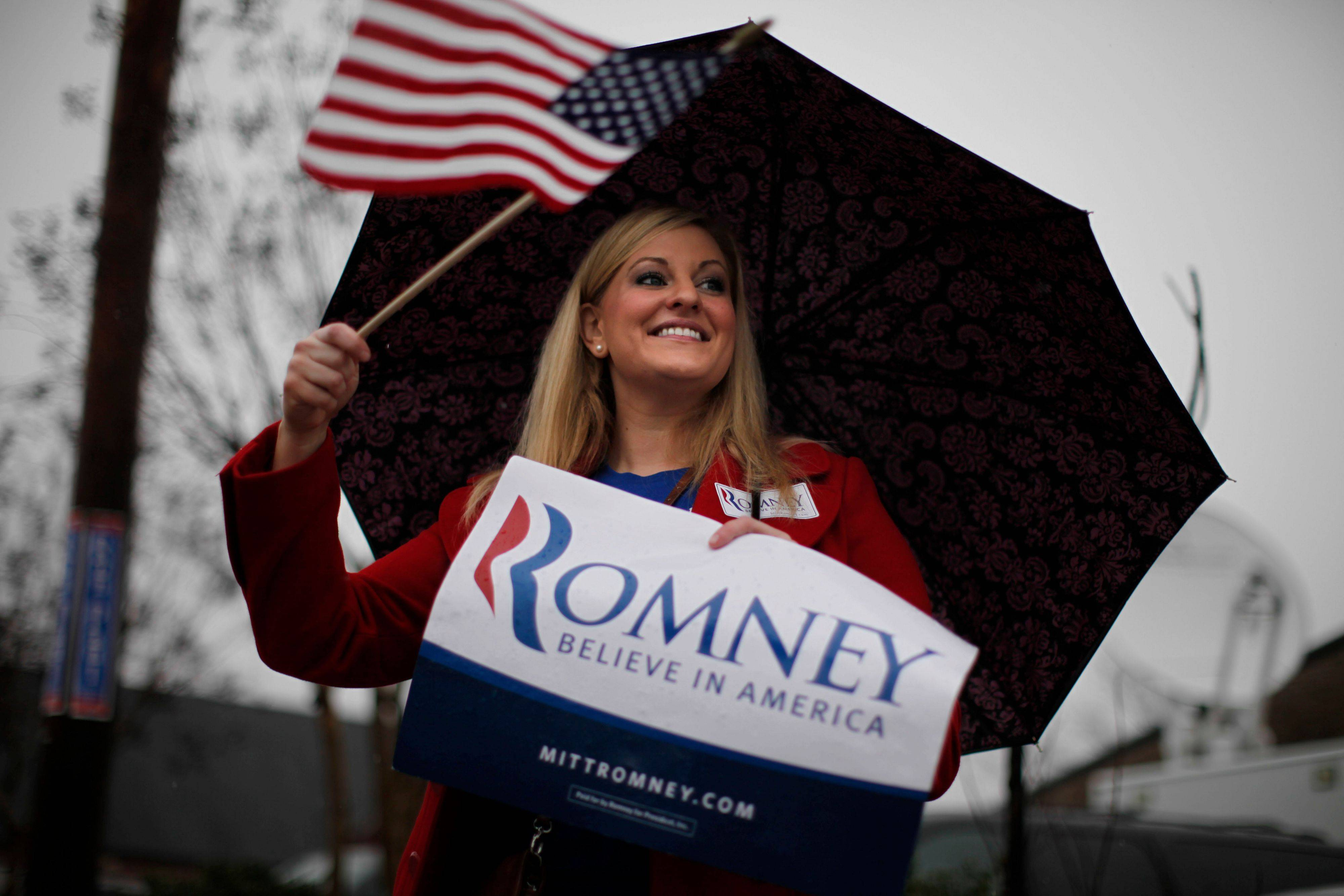 A supporter of Republican presidential candidate former Massachusetts Gov. Mitt Romney displays a sign Saturday during a rainstorm before campaign stops by two Republican presidential candidates, Romney and former House Speaker Newt Gingrich, at Tommyís Country Ham House in Greenville, S.C.