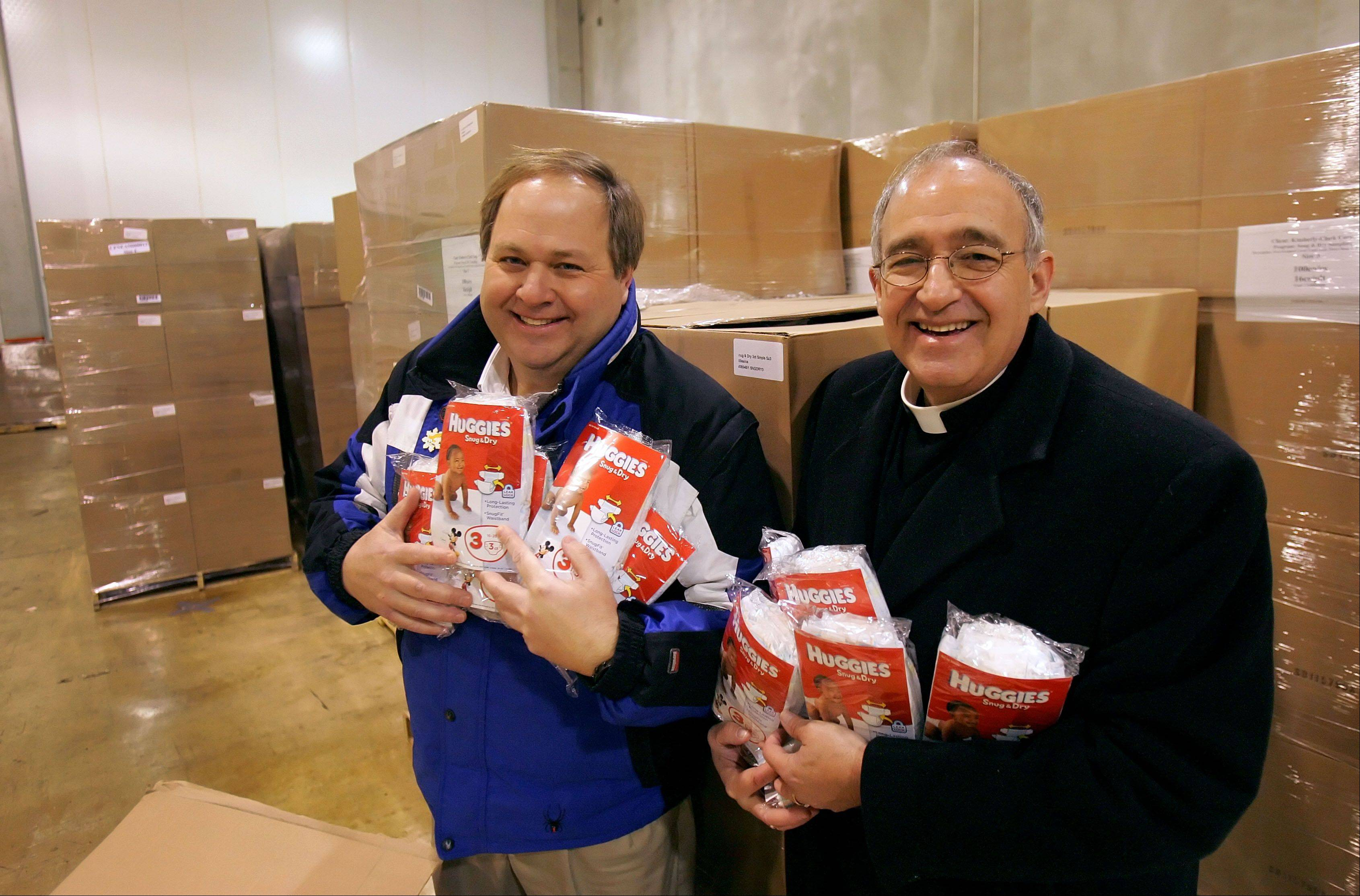 The Rev. Jim Swarthout, right, executive director of Samaritan Interfaith Counseling Center of the Northwest Suburbs, and Wauconda Township Supervisor Glenn Swanson, are working with other agencies to launch a diaper bank in Lake County.