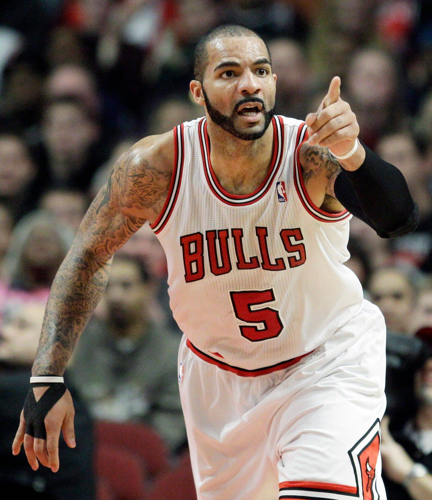 Bulls forward Carlos Boozer reacts Saturday after scoring a basket during the first quarter.