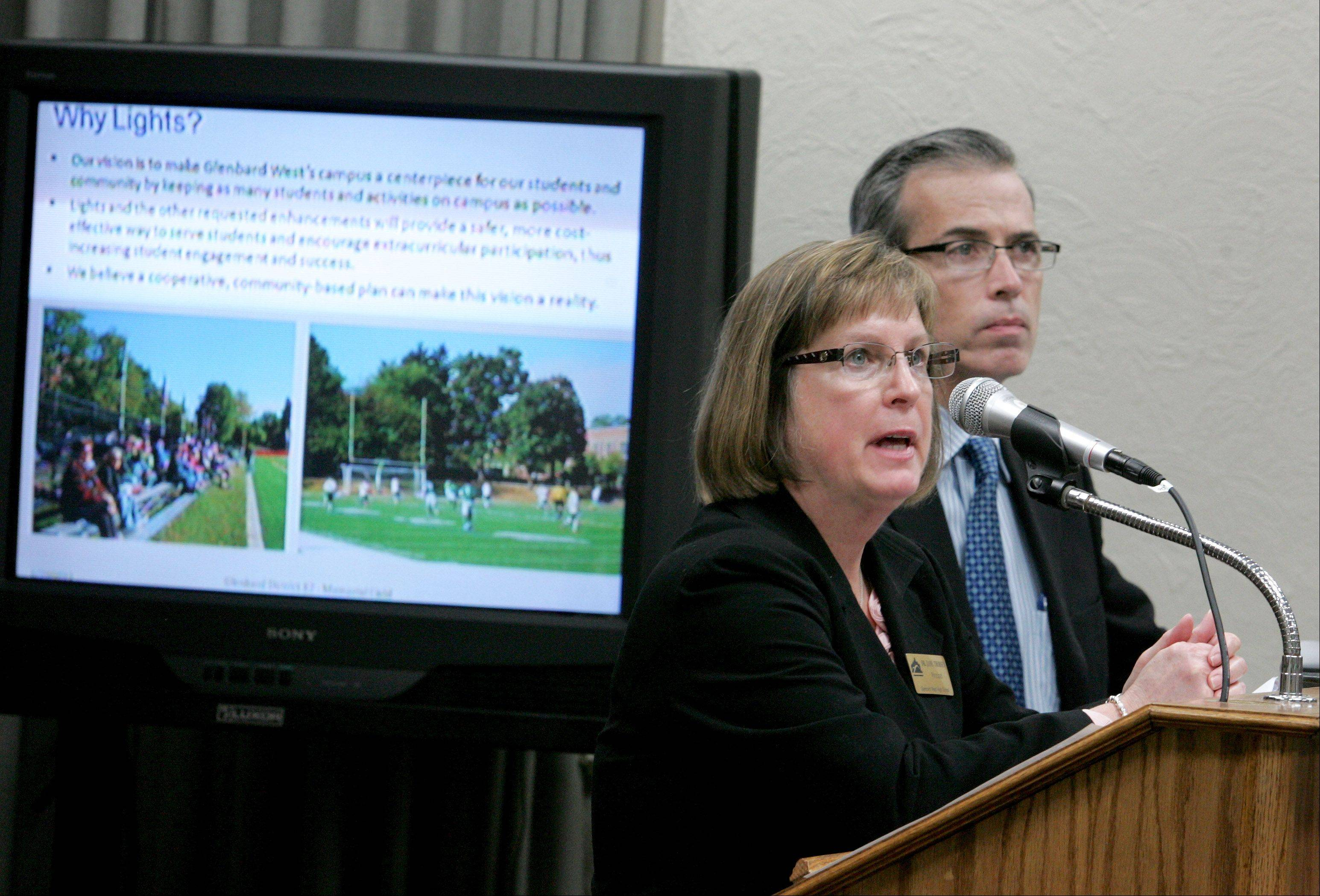 Jane Thorsen, principal of Glenbard West High School, and Patrick Brosnan of Legat Architects speak in favor of lights for Memorial Field during a Glen Ellyn village board meeting Monday.