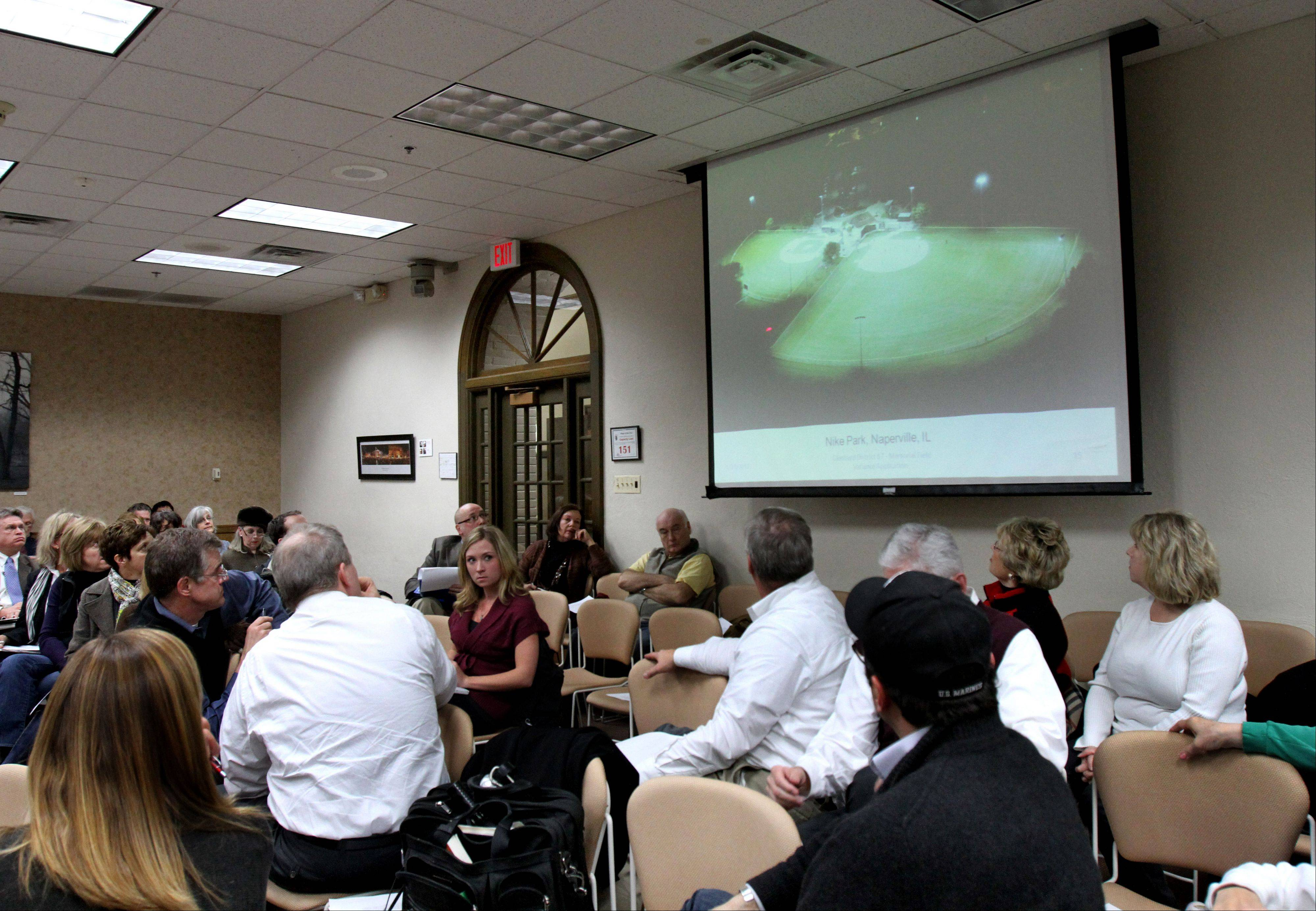Glenbard officials show a photo of Nike Park in Naperville during a Glen Ellyn village board meeting Monday. They say the lighting there is comparable to what is proposed for Memorial Field at Glenbard West.