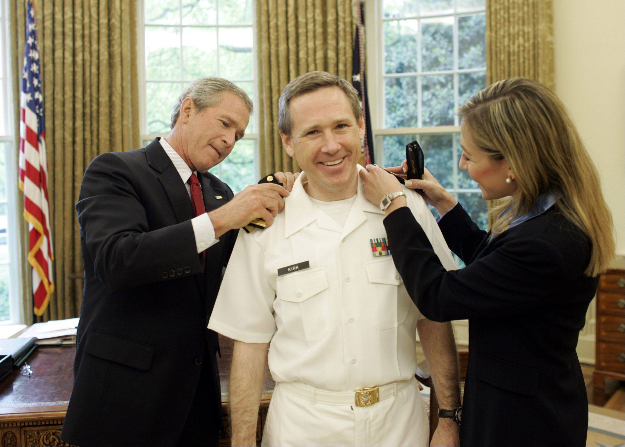 President George W. Bush presides over Rep. Mark Kirk's promotion from Lieutenant Commander to the rank of Commander in the�U.S. Naval Reserves.