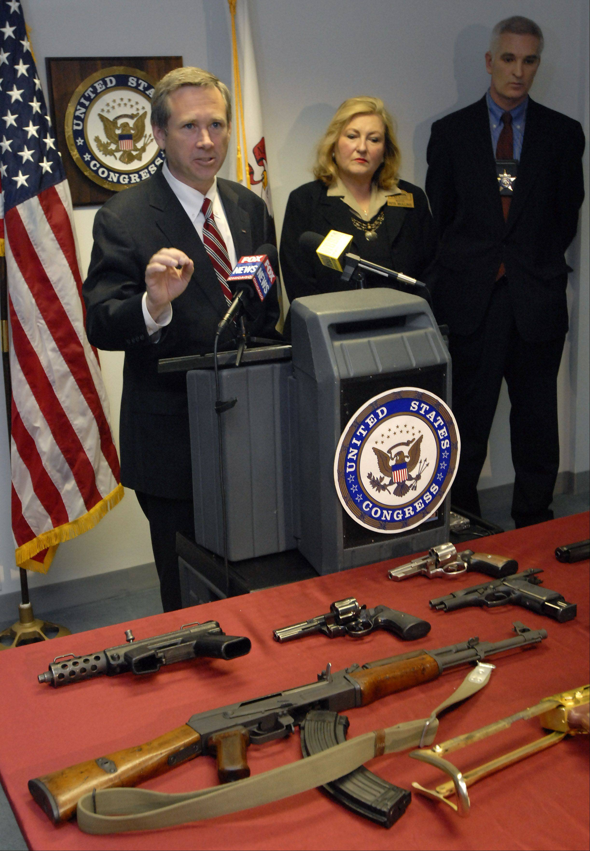With a display of firearms seized in the northern suburbs U.S Rep. Mark Kirk calls for federal action to combat the rise of illegal gun trafficking in the Chicago area at a press conference that included Palatine Mayor Rita Mullins and Lake County Sheriff Mark Curran.