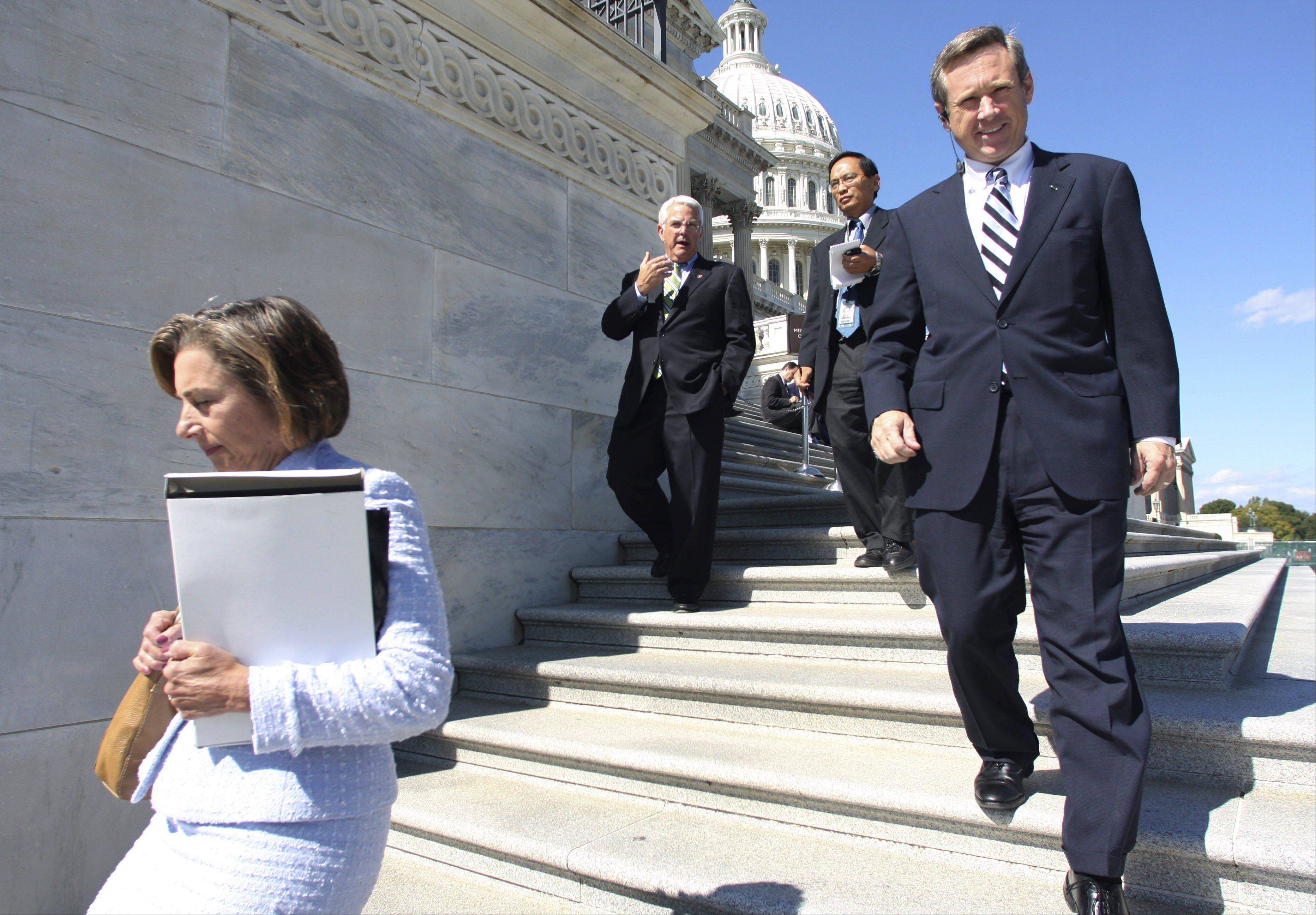 Rep. Janice Schakowsky, D-Ill., left, Rep. John Shadegg, R-Ariz., center, and Rep. Mark Kirk, R-Ill., right, walk down the House steps after voting for the Emergency Economic Stabilization Act of 2008 Friday, Oct. 3, 2008 on Capitol Hill in Washington.