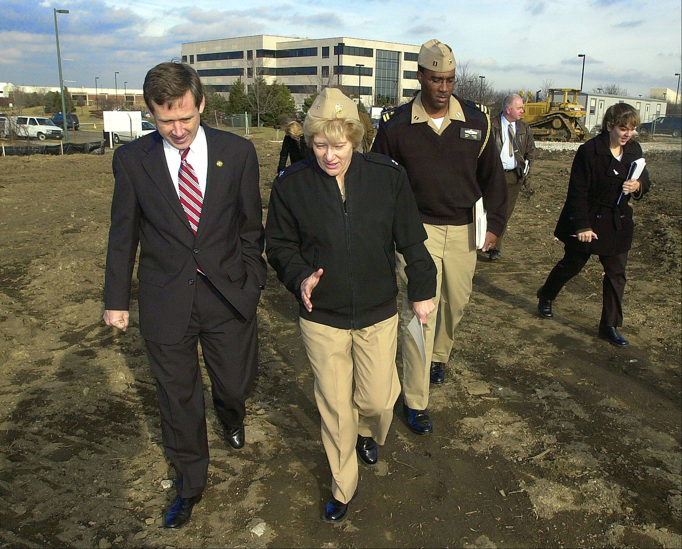 Congressman Mark Kirk and Rear Admiral Ann Rondeau of the Naval Nraining Center Great Lakes walk on the Nike base as they inspect an area that is scheduled for environmental clean up Vernon Hills.
