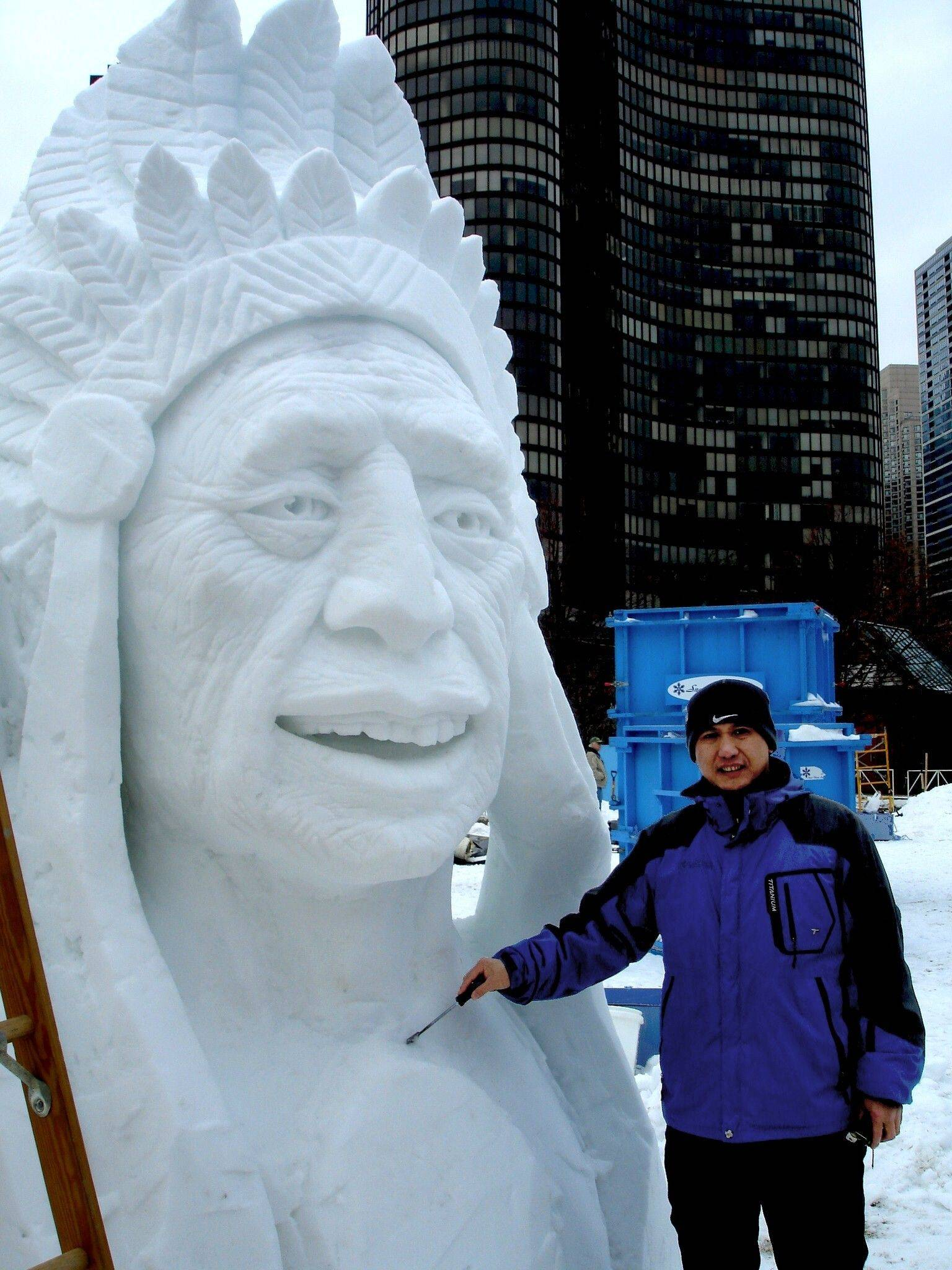 Sculptor Xu Rui from China stands with his sculpture from a past edition of Snow Days Chicago at Navy Pier.