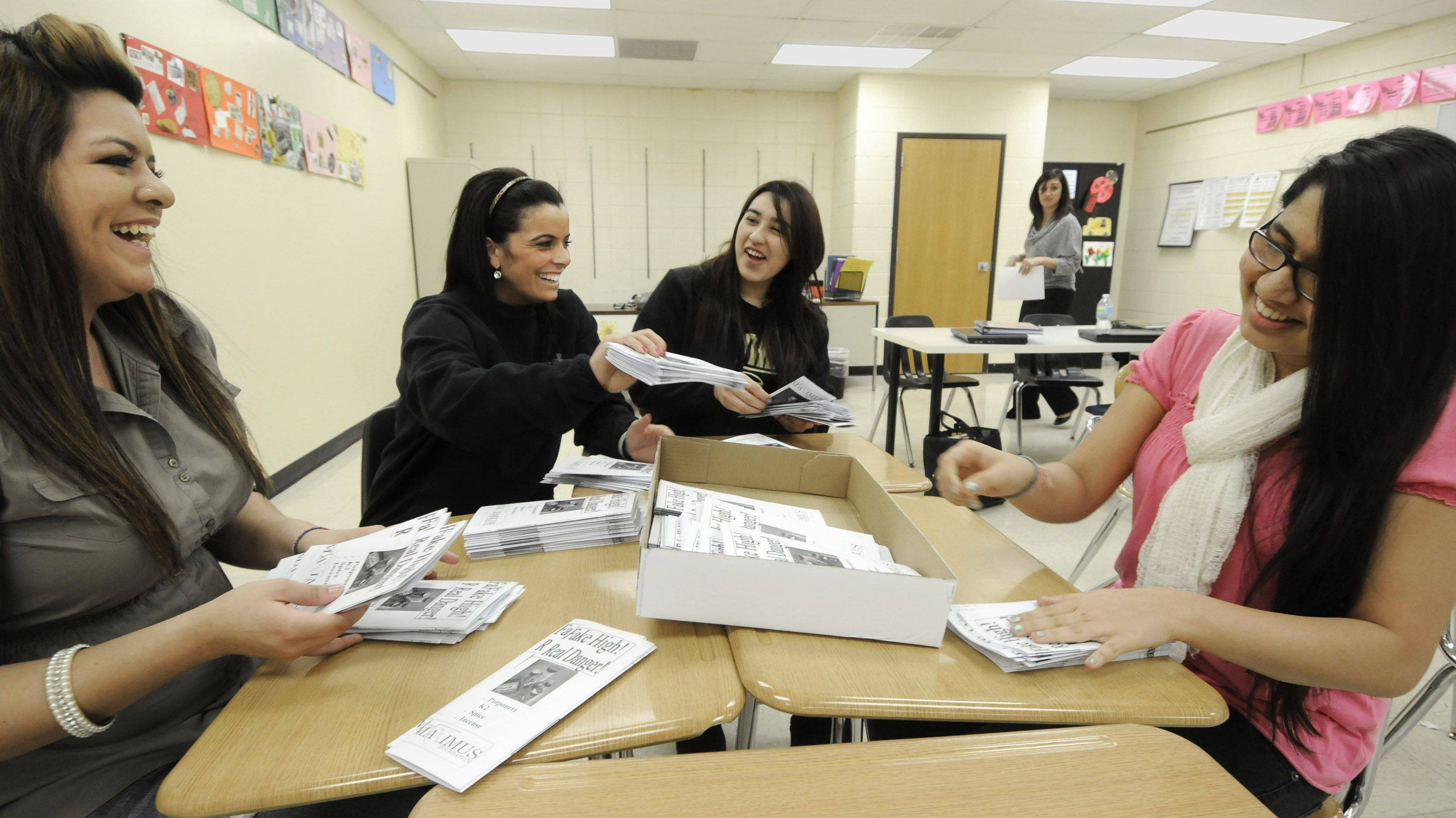 Glenbard North High School Students for Students club members Elizabeth Ayala, Marissa Cusumano, Maria Salas, and Ishita Mehta sort brochures to be handed out at special forum on alcohol and drugs Wednesday night at the school. Cusumano, whose cousin died in November after trying synthetic marijuana, will be speaking at the program. ""