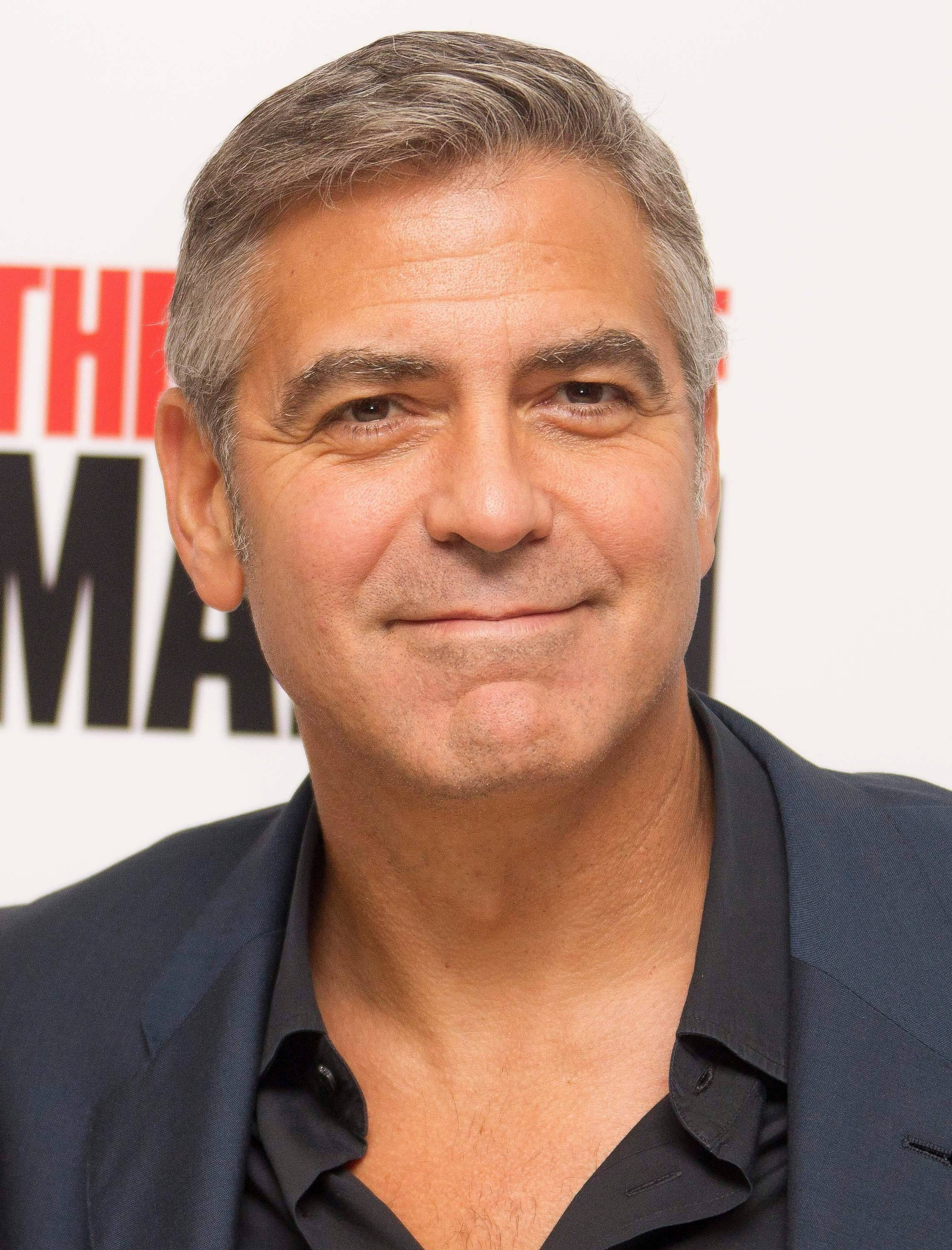 "In this Oct. 19, 2011 file photo, actor and director of the film, George Clooney poses for photographs at the official BFI London Film Festival screening of ""The Ides of March,"" in London. Clooney was nominated Tuesday, Jan. 24, 2012 for best actor for his role in ""The Descendants."""