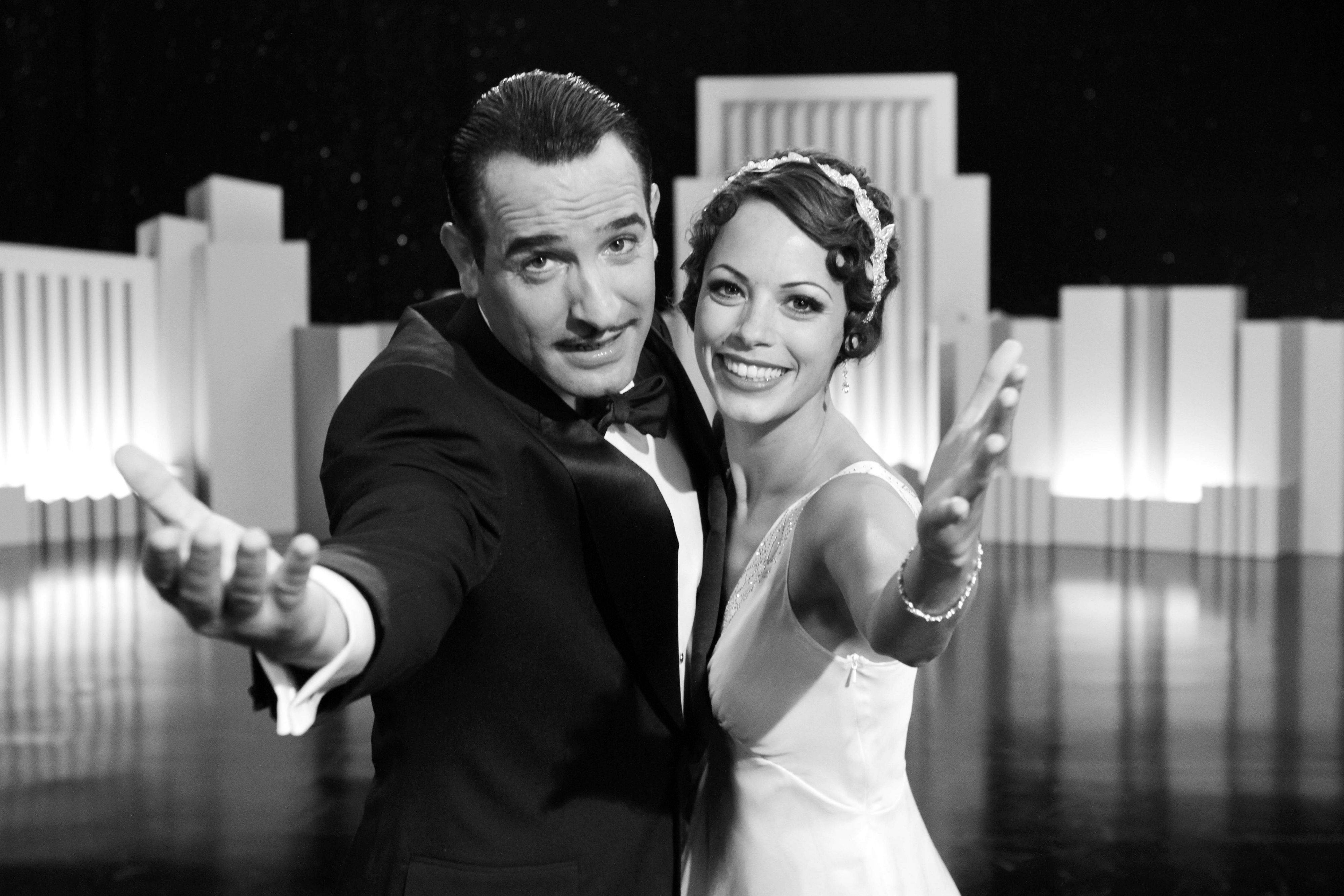 "In this file film publicity image released by The Weinstein Company, Jean Dujardin portrays George Valentin, left, and Berenice Bejo portrays Peppy Miller in a scene from ""The Artist."" The film was nominated Tuesday, Jan. 24, 2012 for an Oscar for best film."