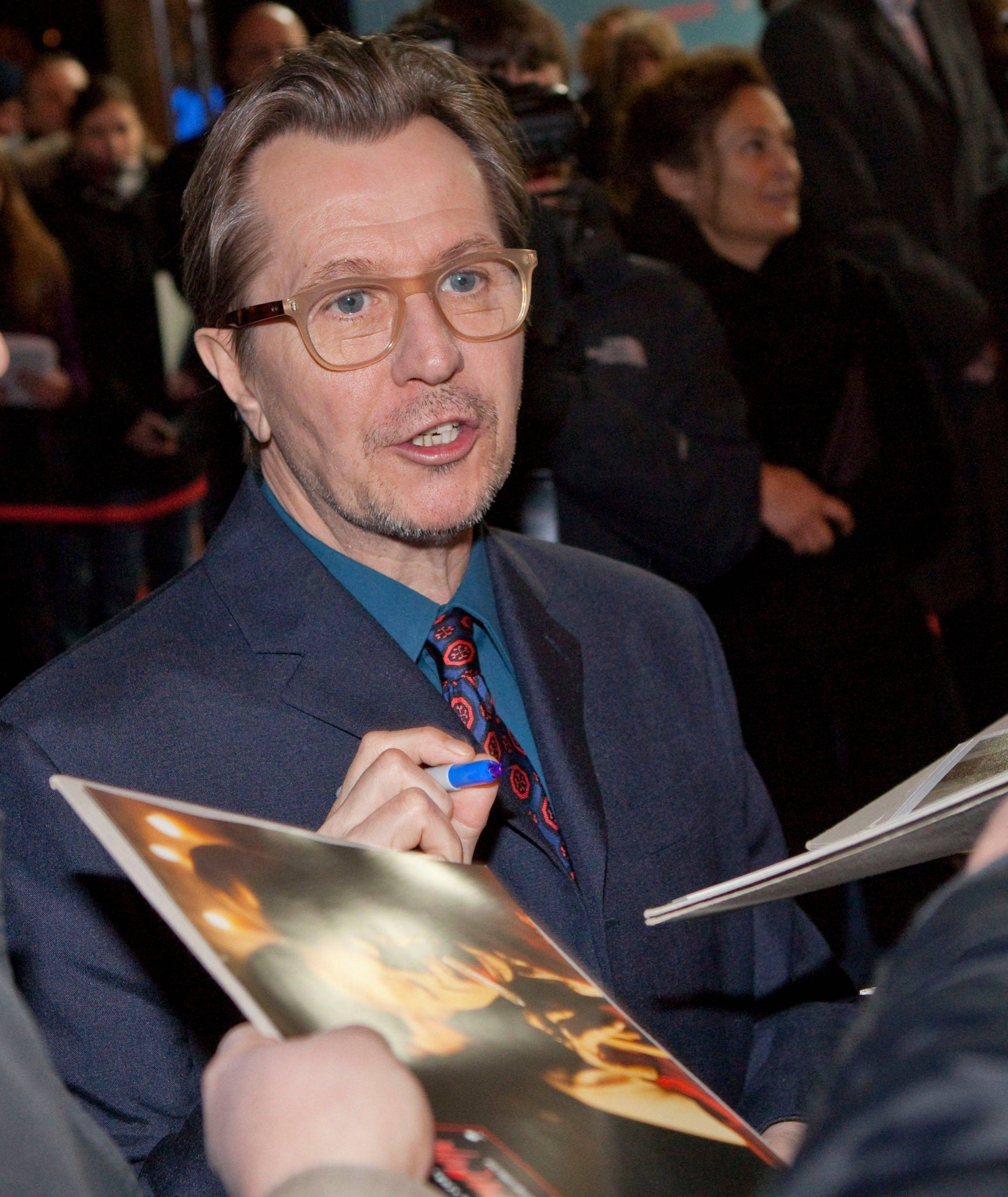 "British actor Gary Oldman signs autographs before the German premiere of the movie ""Dame, K�nig, As, Spion"" (original title ""Tinker Tailor Soldier Spy"") in Berlin, Germany, Tuesday, Jan. 24, 2012. Oldman was nominated Tuesday, Jan. 24, 2012 for an Academy Award for best actor for his role in the film."
