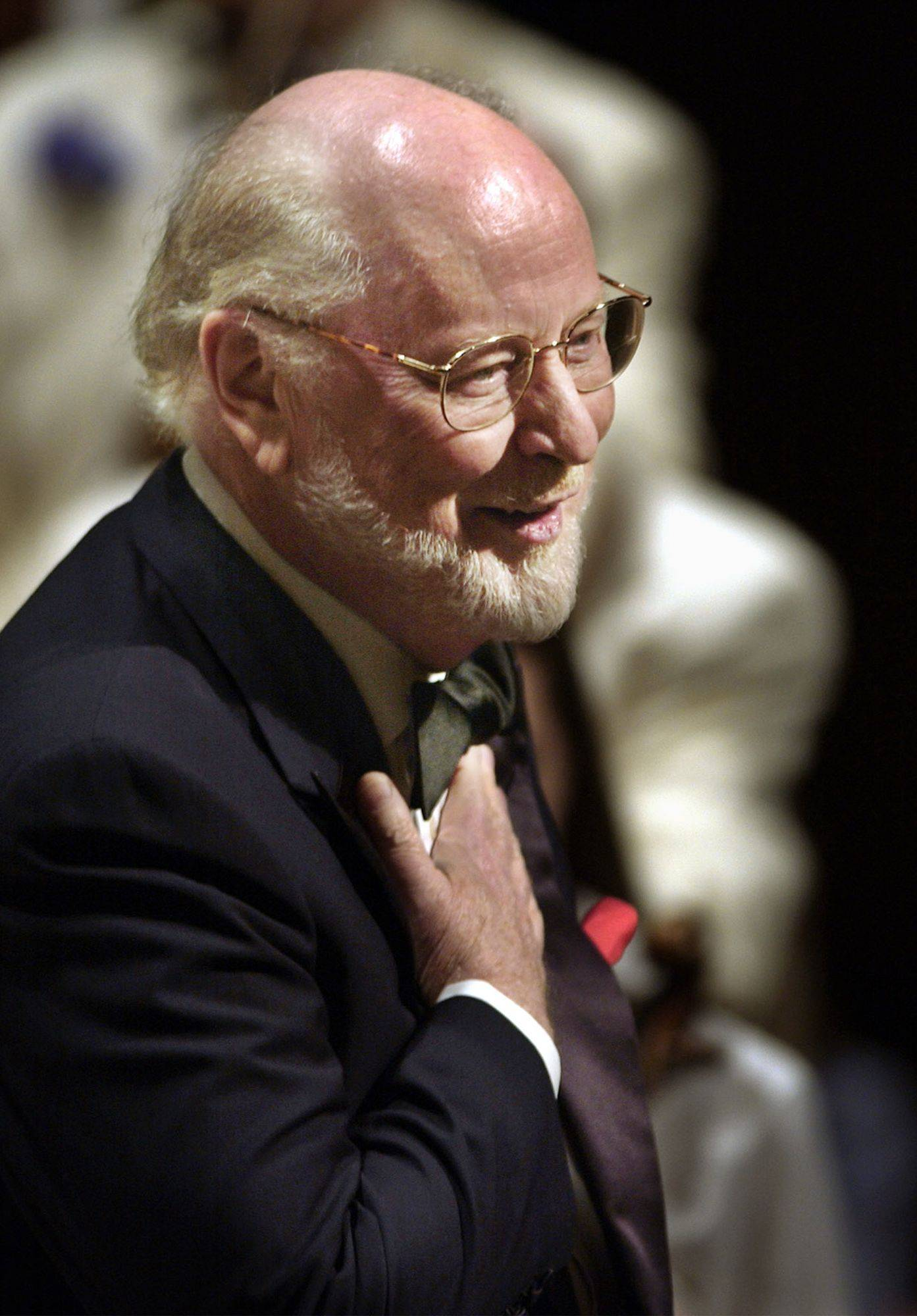 "Composer and conductor John Williams, shown on stage at Boston's Symphony Hall in this May 28, 2002, file photo. The prolific composer, who wrote the theme song for four Olympic Games and perhaps best known for composing the ``Star Wars'' film score, is nominated for two 2012 Oscars for best original score (""The Adventures of Tintin"" and ""War Horse"") giving him a record 47 Oscar nods in total."