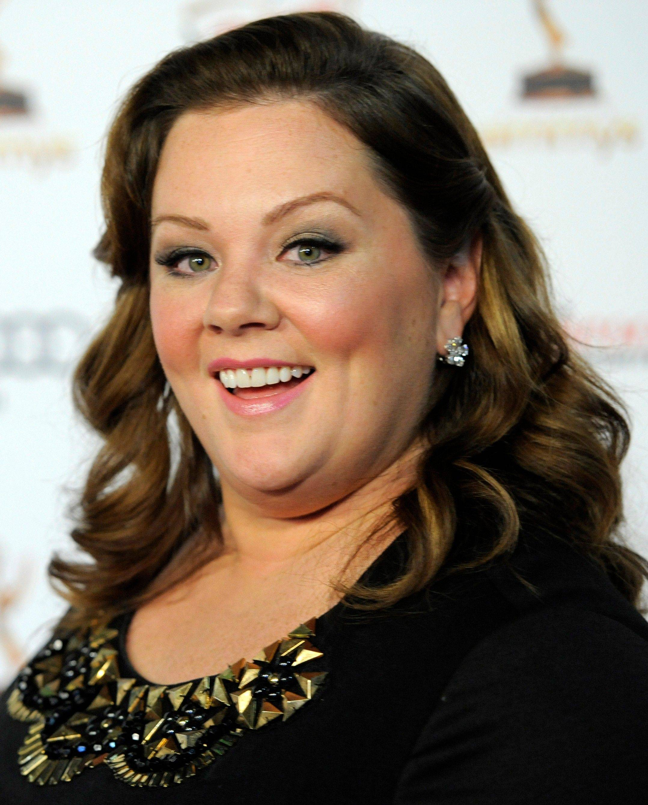 "In this Sept. 16, 2011 file photo, Melissa McCarthy poses at the 63rd Primetime Emmy Awards Performers Nominee Reception in Los Angeles. McCarthy was nominated Tuesday, Jan. 24, 2012 for an Academy Award for best supporting actress for her role in ""Bridesmaids."""