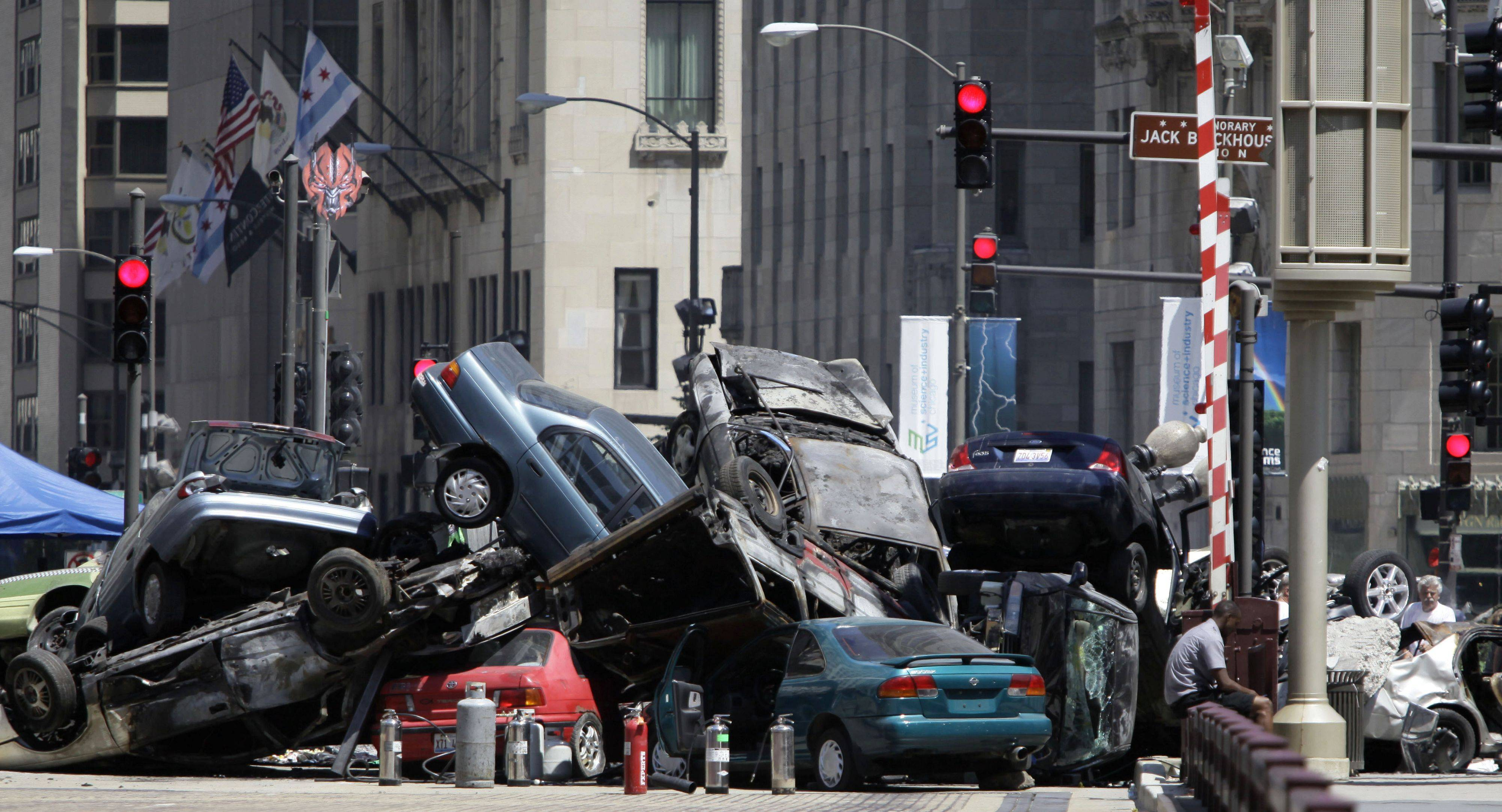 "Cars are seen piled up in a plaza along Michigan Avenue in downtown Chicago, Friday, July 16, 2010, during filming of the movie ""Transformers Dark of the Moon."" The film was nominated for three technical Oscars (sound mixing, sound editing, visual effects)"