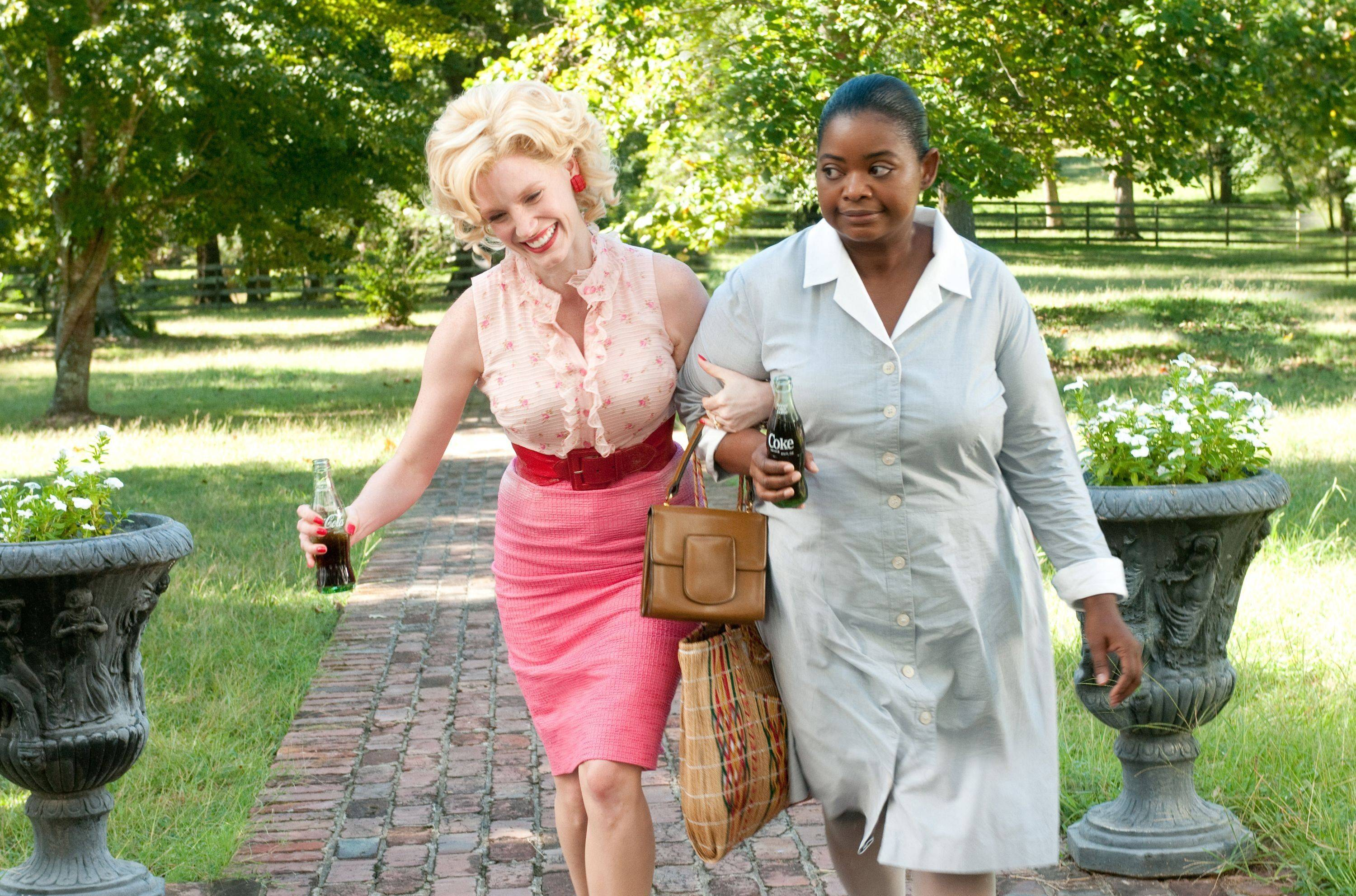 "In this image released by Disney DreamWorks II, Jessica Chastain portrays Celia Foote, left, and Octavia Spencer portrays Minny Jackson, in a scene from ""The Help."" Both Chastain and Spencer were nominated Tuesday, Jan. 24, 2012 for an Academy Award for best supporting actress for their roles in the film."