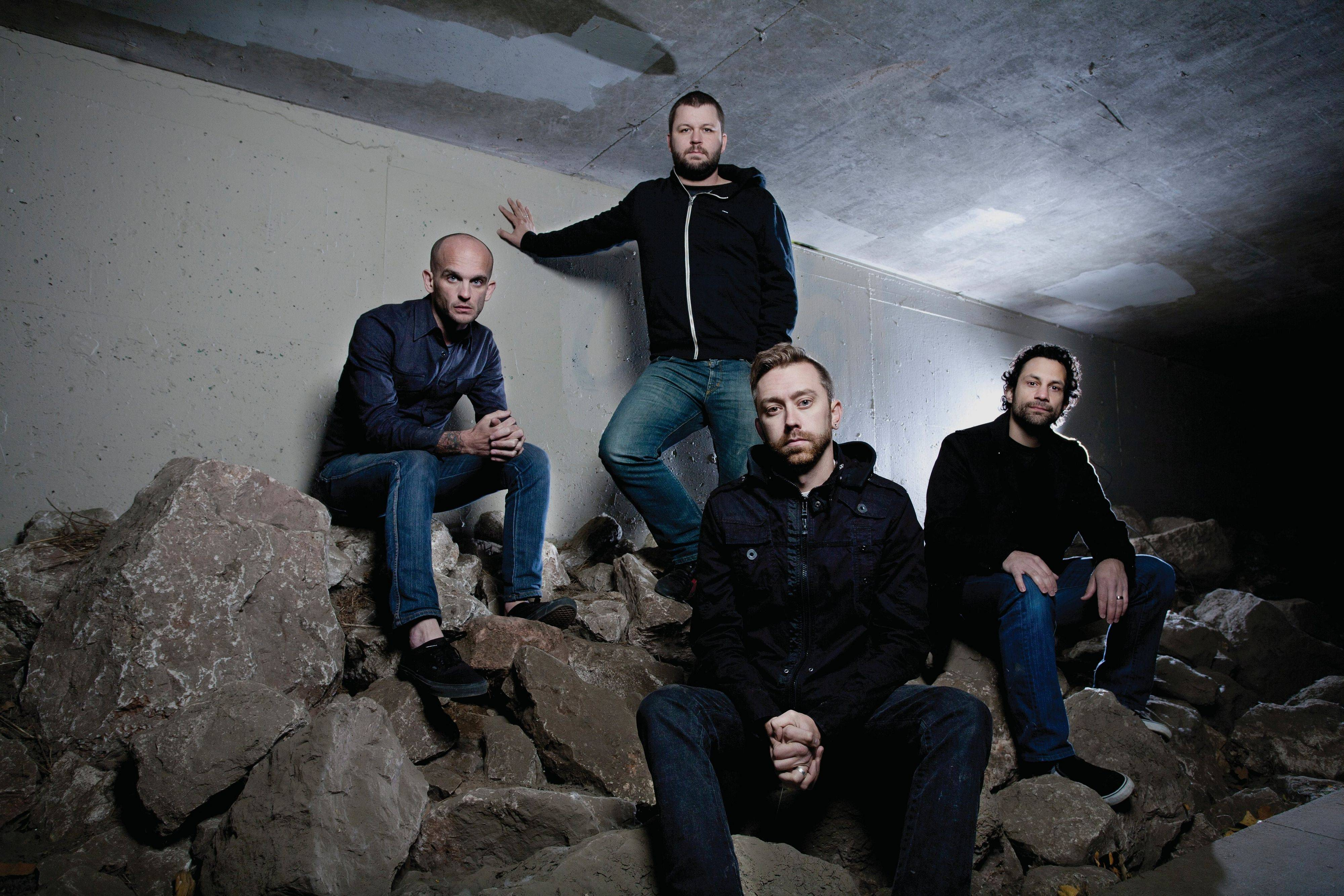 The popular punk band Rise Against is, from left to right, guitarist Zach Blair of Austin, Texas, drummer Brandon Barnes of Norridge, lead vocalist Tim McIlrath of Arlington Heights, and bass guitarist Joe Principe of Downers Grove.