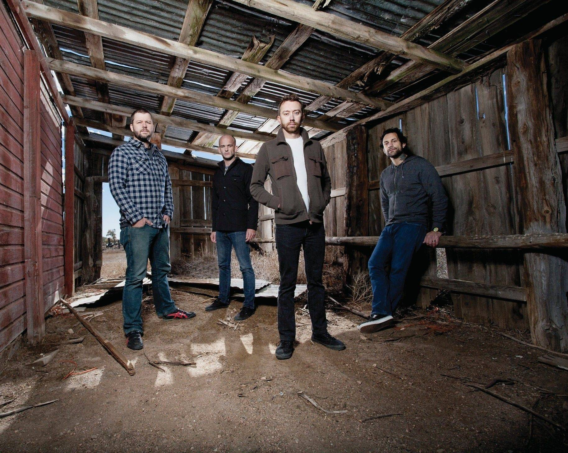 The popular punk band Rise Against is, from left to right, drummer Brandon Barnes of Norridge, guitarist Zach Blair of Austin, Texas, lead vocalist Tim McIlrath of Arlington Heights, and bass guitarist Joe Principe of Downers Grove.
