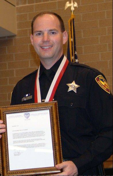 North Aurora police officer honored
