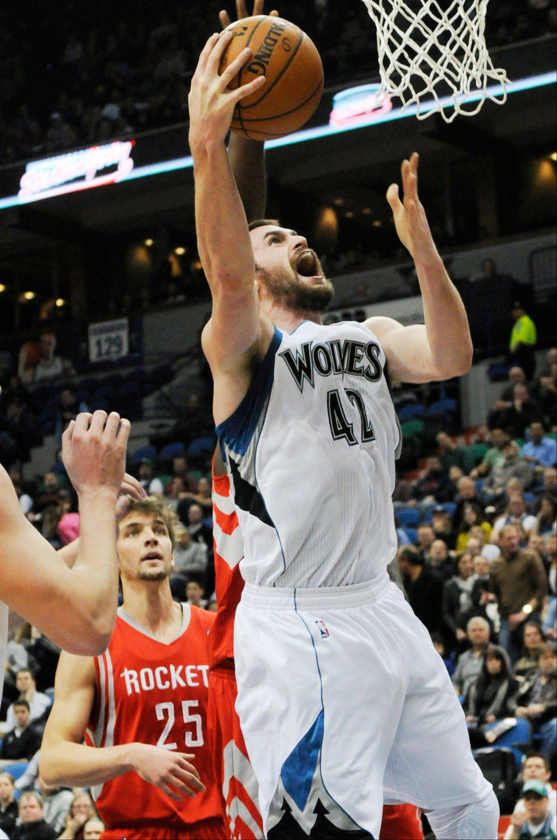 AP source: Timberwolves, Love reach 4-year extension