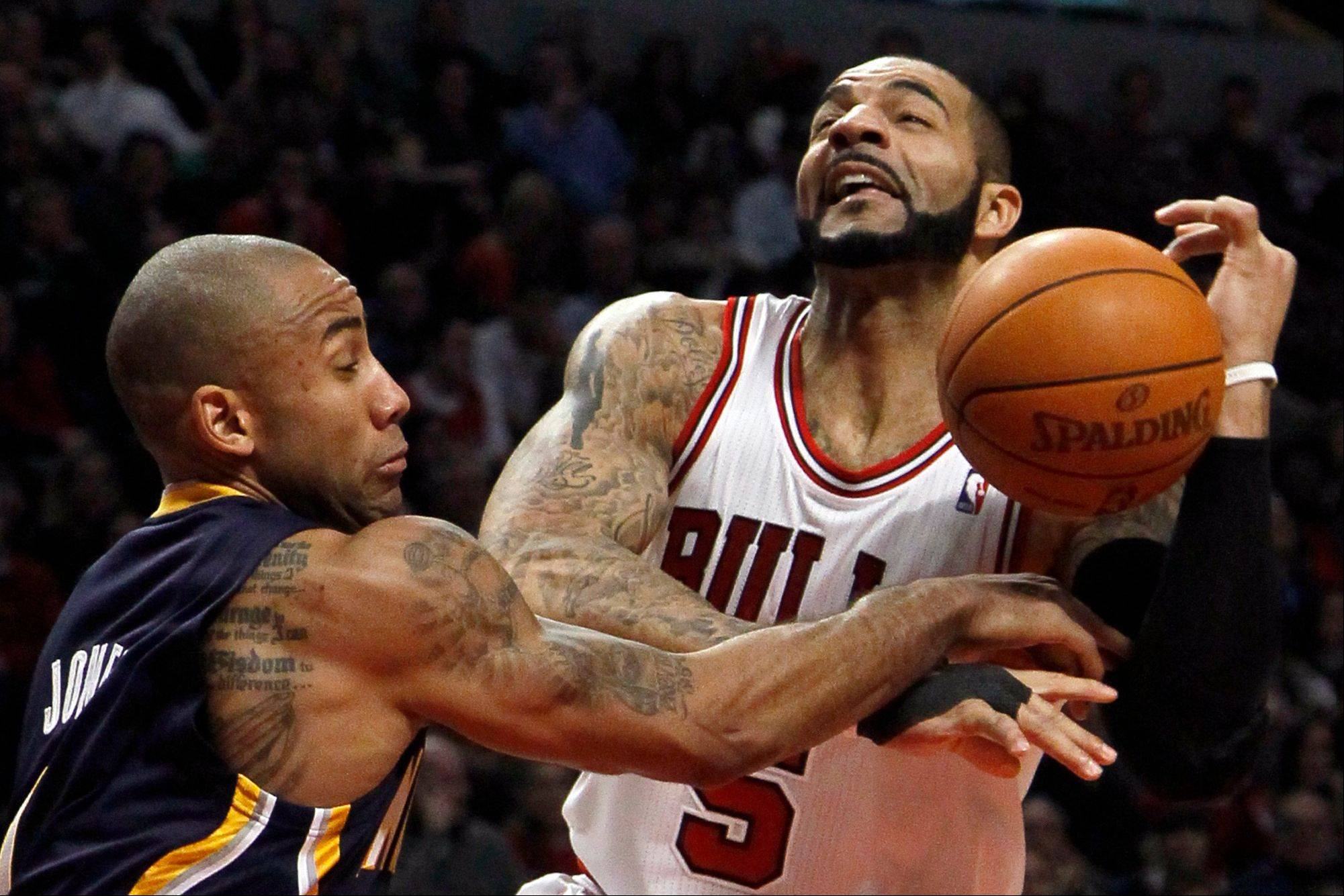 Indiana Pacers guard Dahntay Jones, left, fouls forward Carlos Boozer during the first half Wednesday. Last year's first-round playoff series between the Bulls and Pacers was marked by physical play, an approach Pacers coach Jeff Vogel says the team will continue this season.