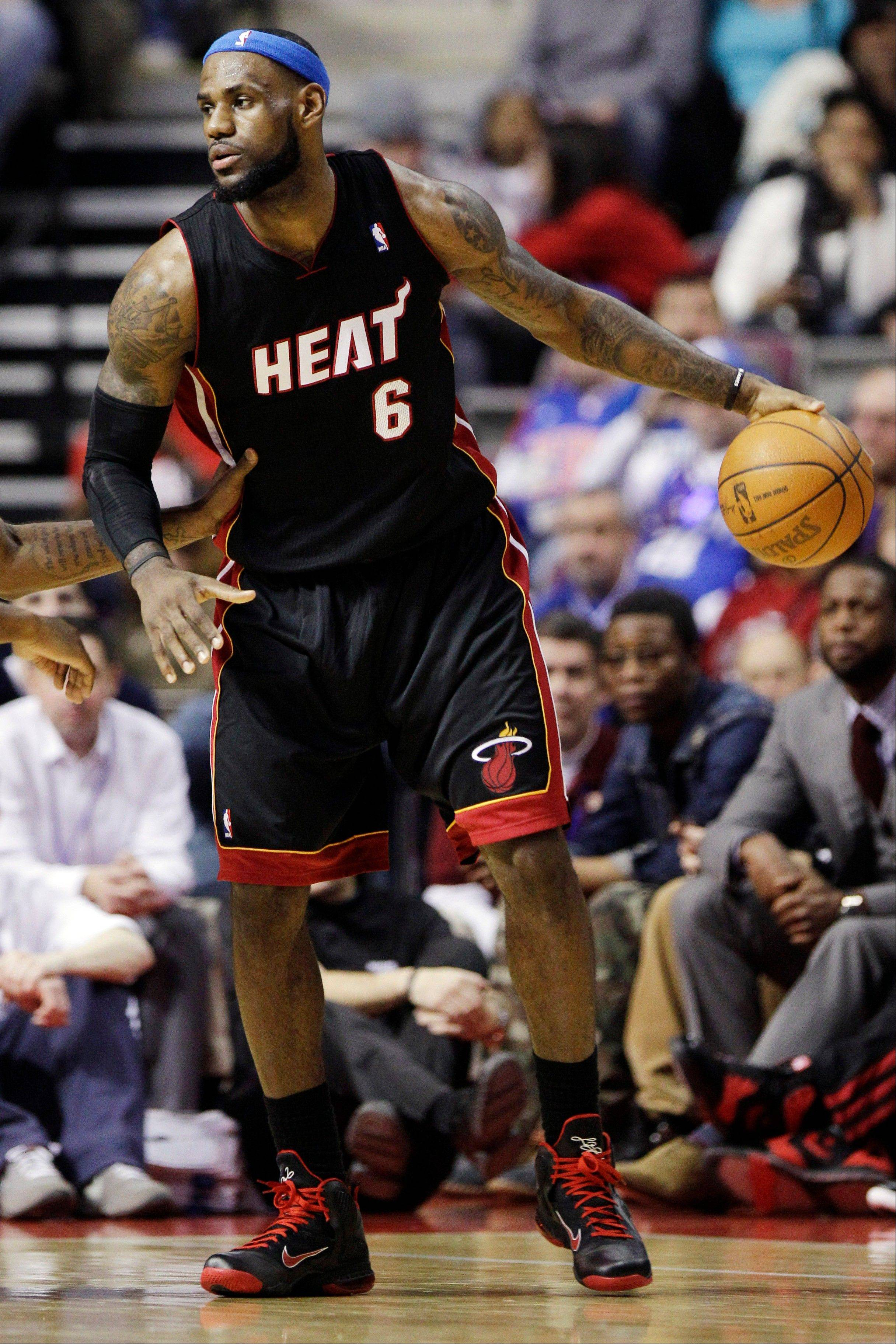 Miami Heat forward LeBron James dribbles Wednesday during the first quarter.