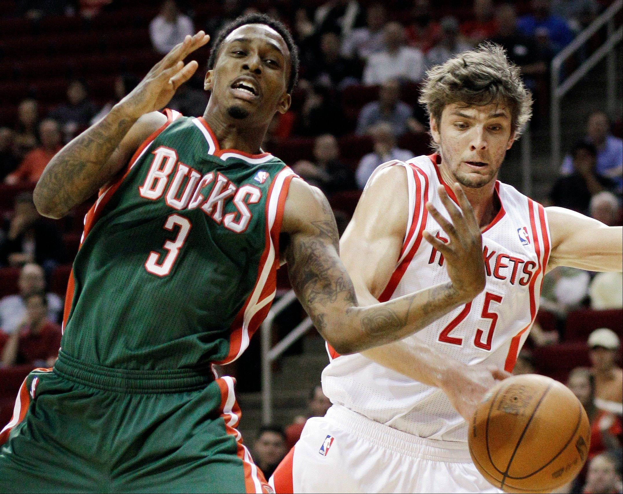 Milwaukee Bucks guard Brandon Jennings loses the ball on a steal Wednesday from the Houston Rockets' Chandler Parsons in the first half.