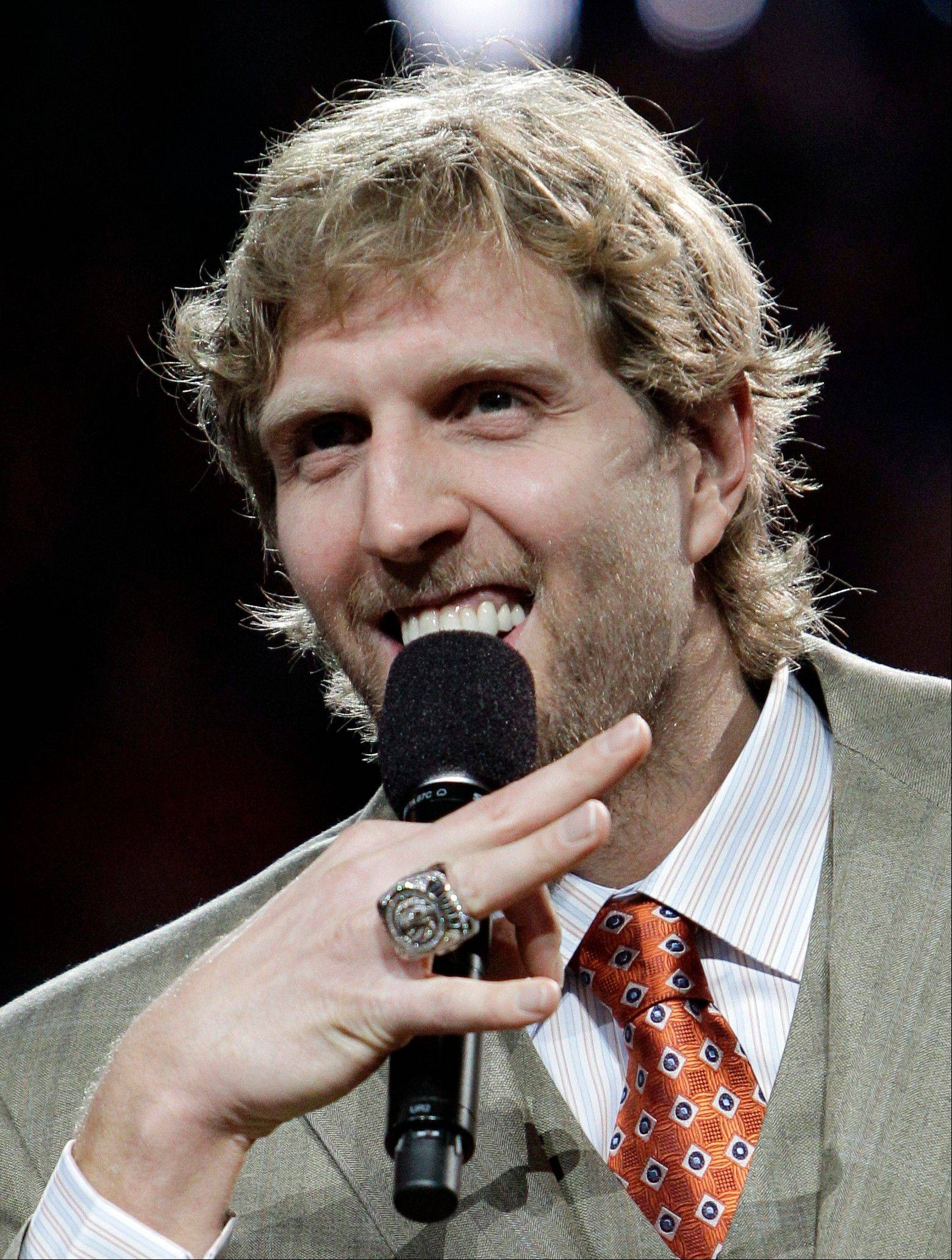 Dirk Nowitzki addresses the crowd after the NBA championship ring presentation Wednesday in Dallas.