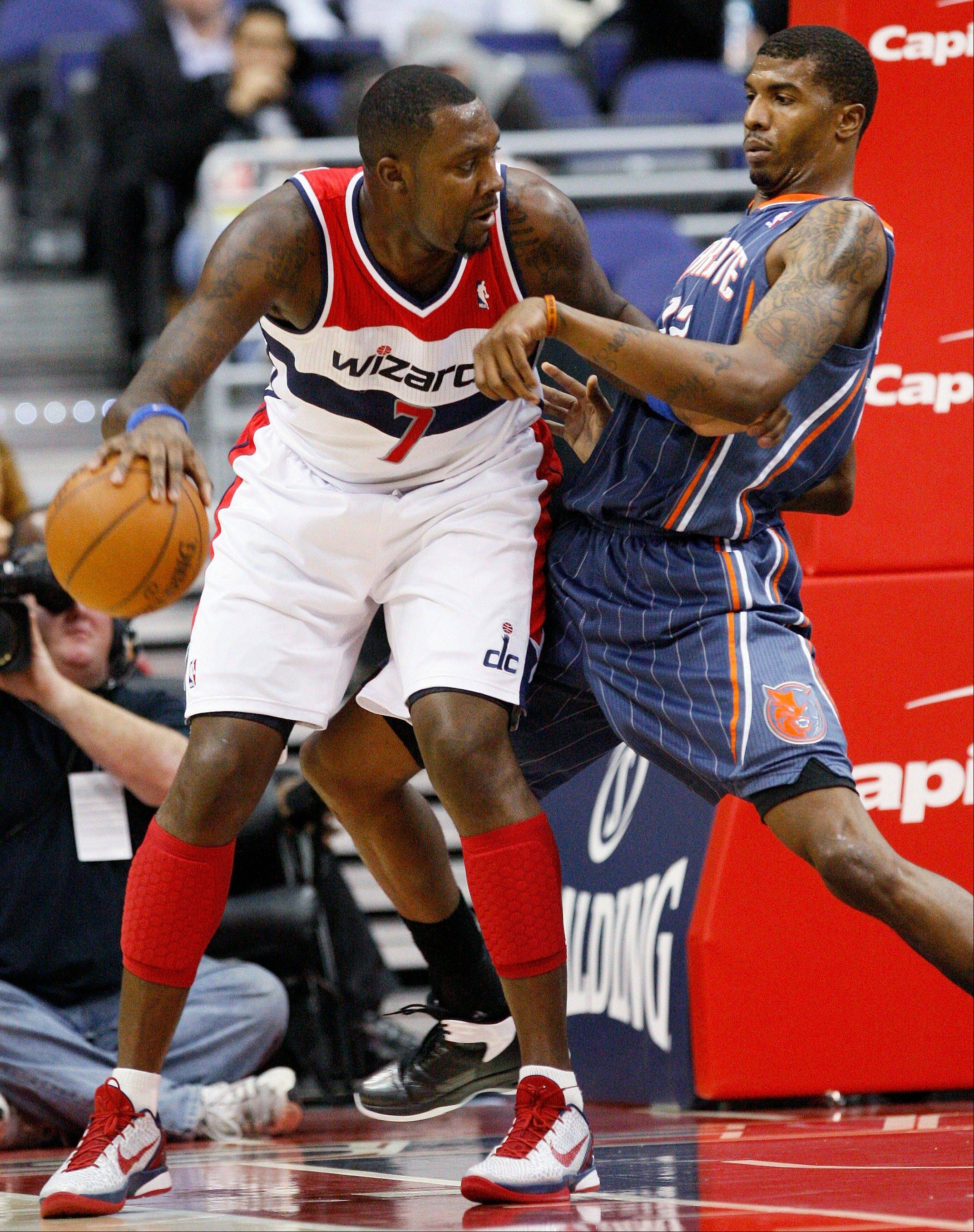 Washington Wizards forward Andray Blatche drives Wednesday against Charlotte Bobcats forward Tyrus Thomas during the first quarter.