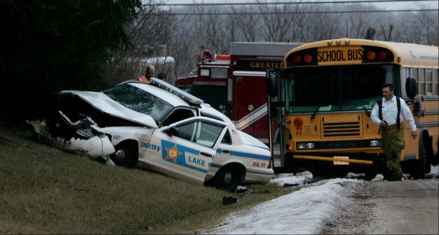 Three injured when school bus, squad car collide
