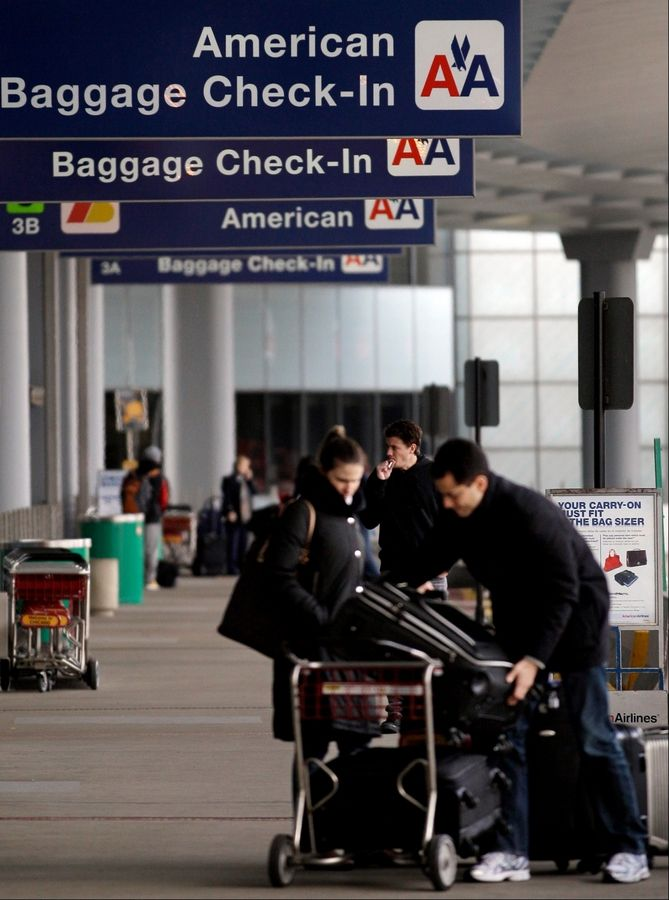 Passengers arrive at an American Airlines baggage check-in area Nov. 29 at O'Hare International Airport in Chicago. Traffic was down at O'Hare in 2011, dipping 0.4 percent to nearly 879,000 takeoffs and landings.