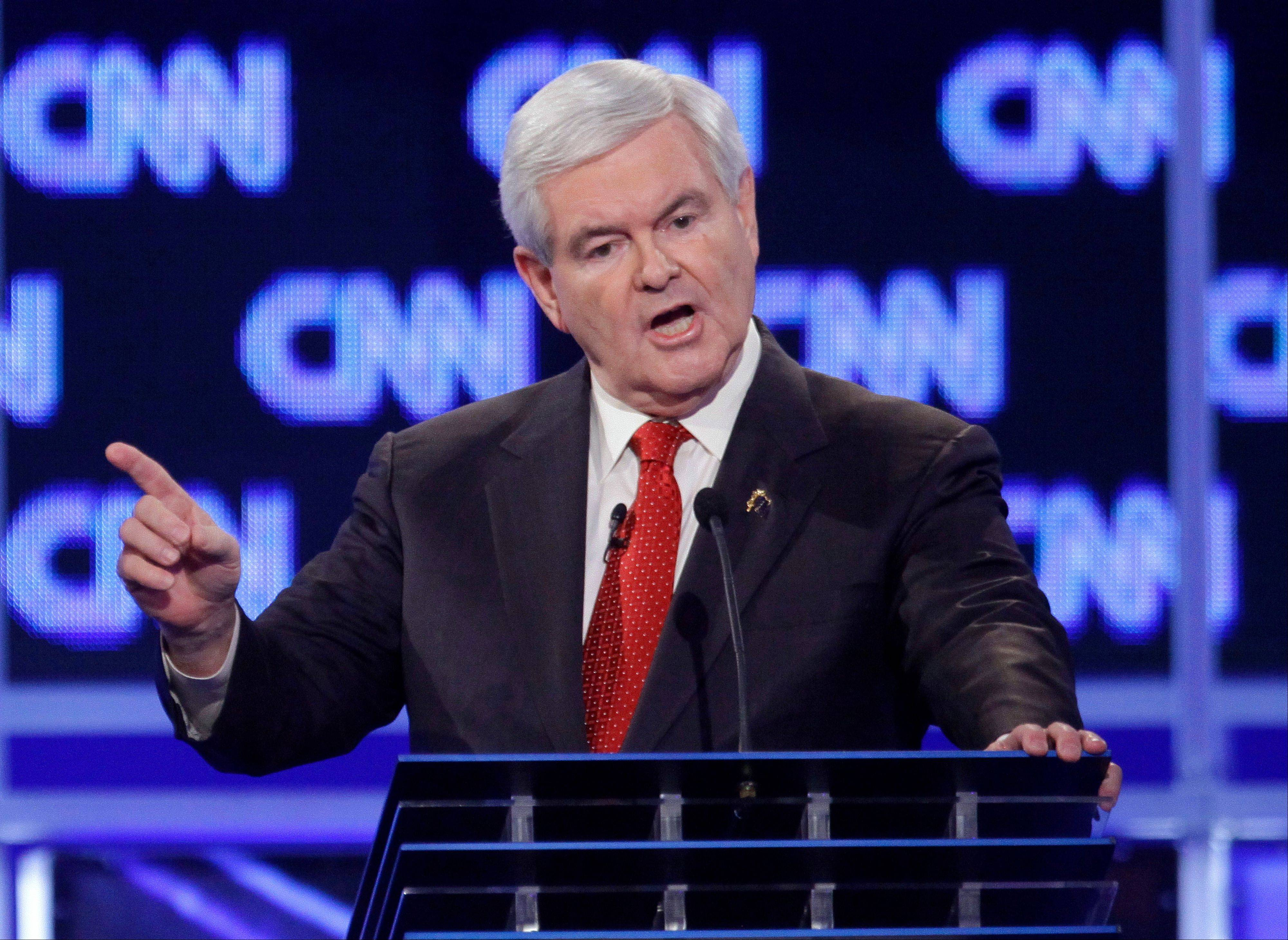 "Republican presidential candidate former House Speaker Newt Gingrich reacts to a question at the start of the Republican presidential candidate debate at the North Charleston Coliseum in Charleston, S.C., Thursday, Jan. 19, 2012. Gingrich is denying that he ever asked his ex-wife for an open marriage and angrily denounced CNN's John King, moderator of Thursday night's Republican debate for raising the issue. Gingrich blasted what he called the ""destructive, vicious, negative nature of much of the news media."""