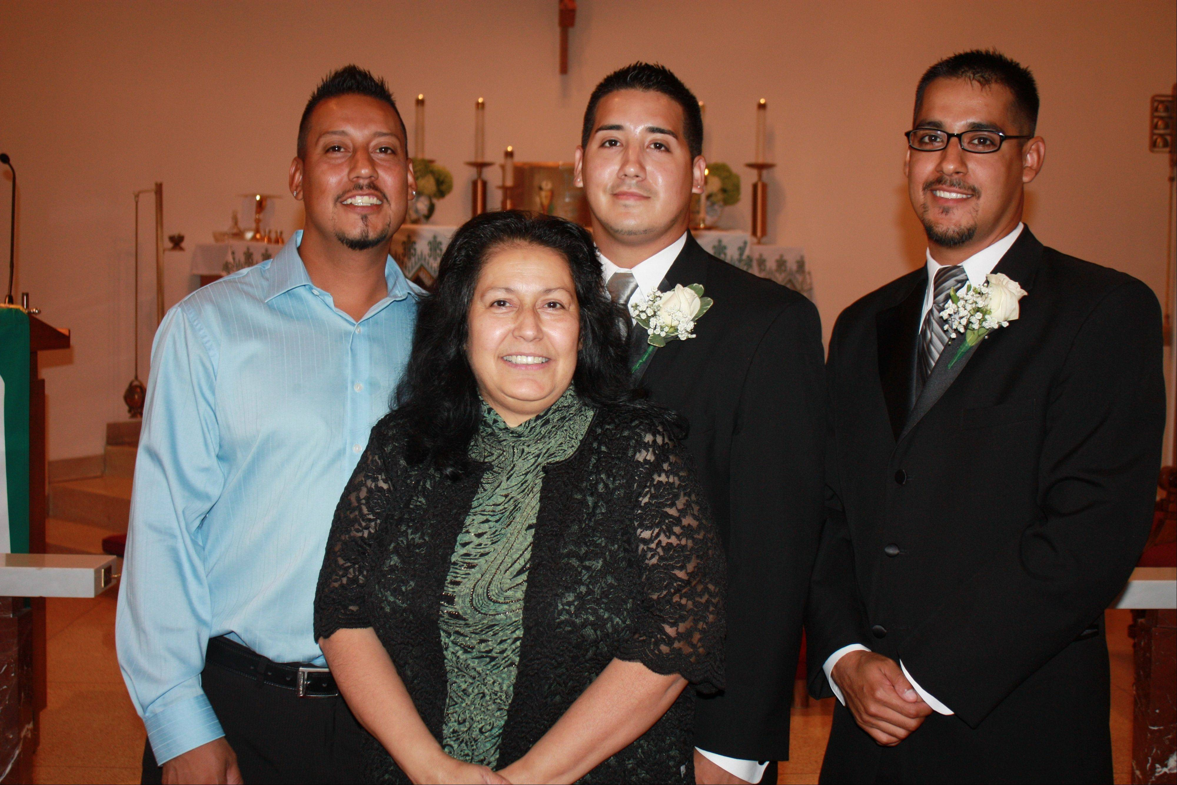 Angelita James, with her sons Lupe Martinez, left, Efren Galvan and Noe Corrall Galvan. The photo was taken the day Efren Galvan renewed his wedding vows.