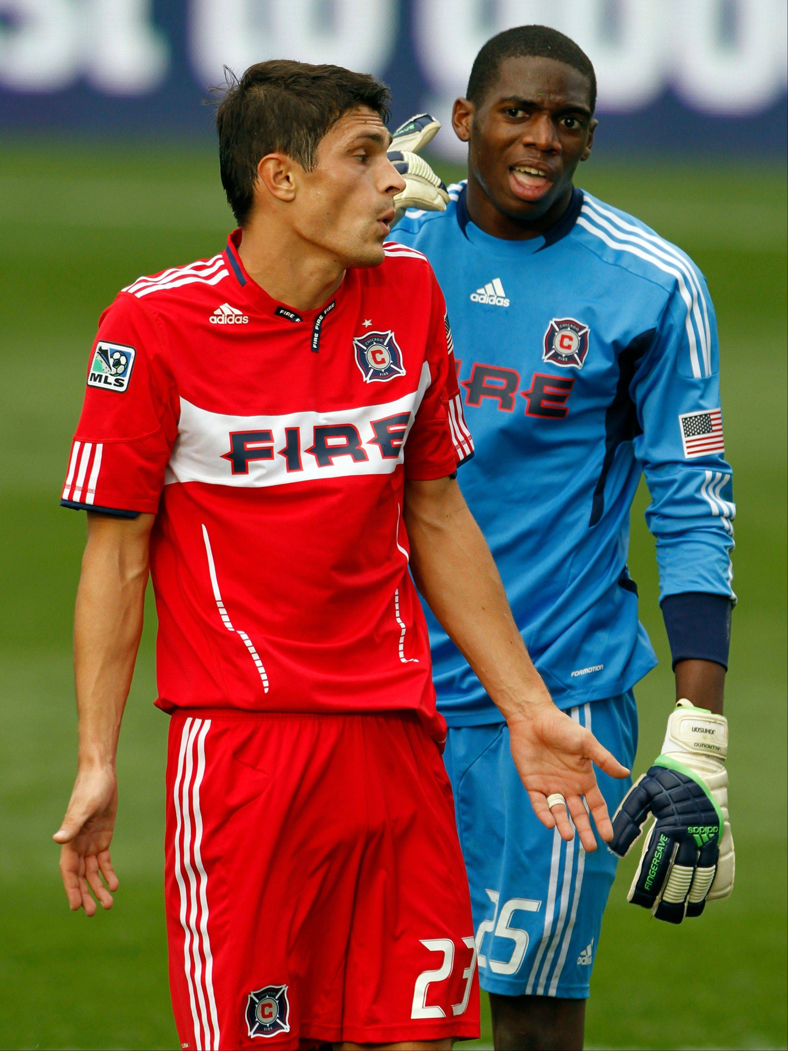 Chicago Fire goalie Sean Johnson, right, argues with teammate Josip Mikulic, left, after a close play in front of the net during the second half of an MLS soccer game in Bridgeview on Sunday, Sept. 25, 2011. The Fire defeated the Revolution 3-2.
