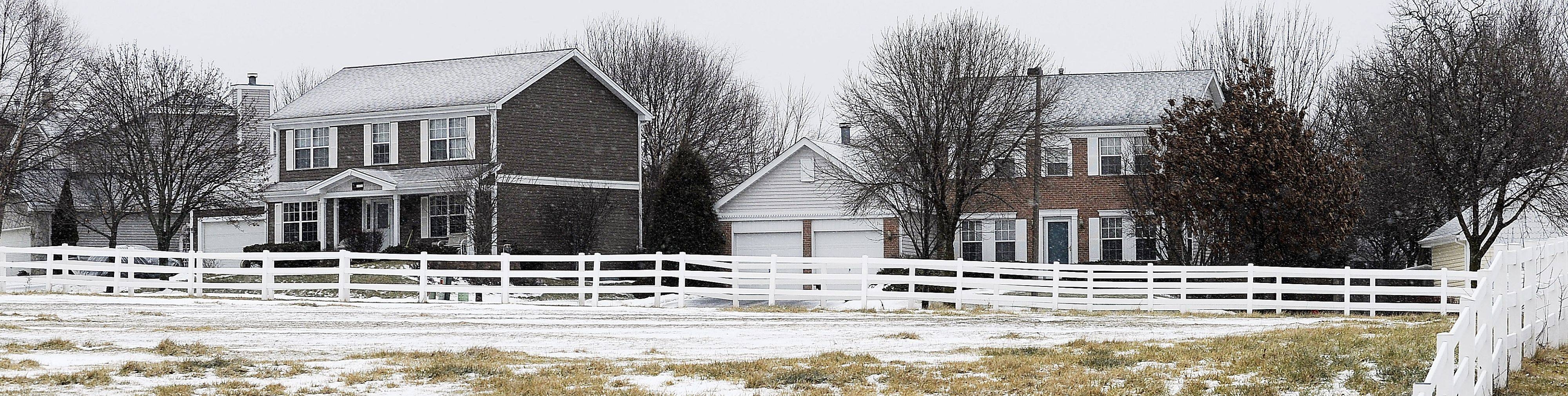 A white fence that surrounds Little Creek Quarter Horse Farm provides a lovely view for homeowners in the neighborhood.