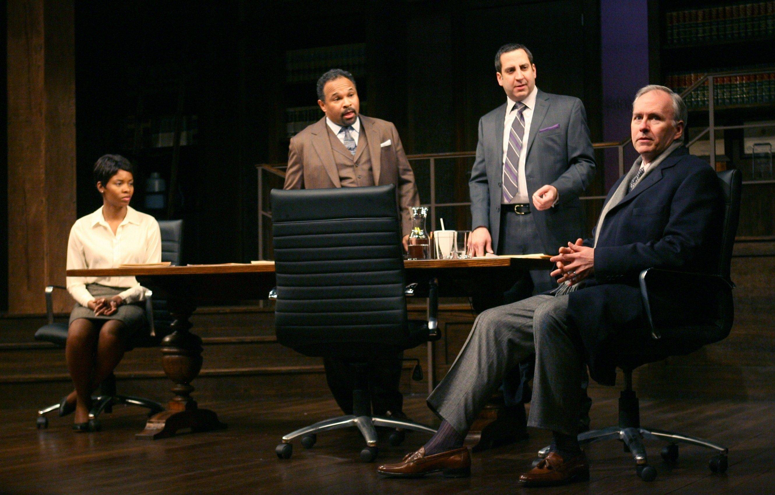 "Newly hired associate Susan (Tamberla Perry), left, and law partners Henry (Geoffrey Owens), second from left, and Jack (Marc Grapey) confront potential client Charles Strickland (Patrick Clear) in Goodman Theatre's blistering revival of David Mamet's ""Race."""