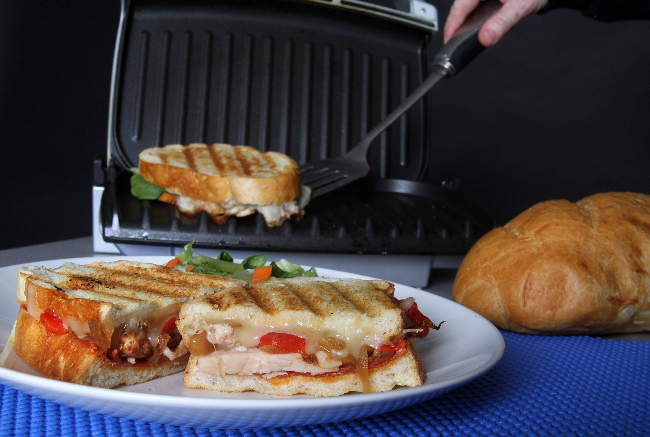 George LeClaireThis panini has pepperoni and grilled chicken, but you can use any meat you like.