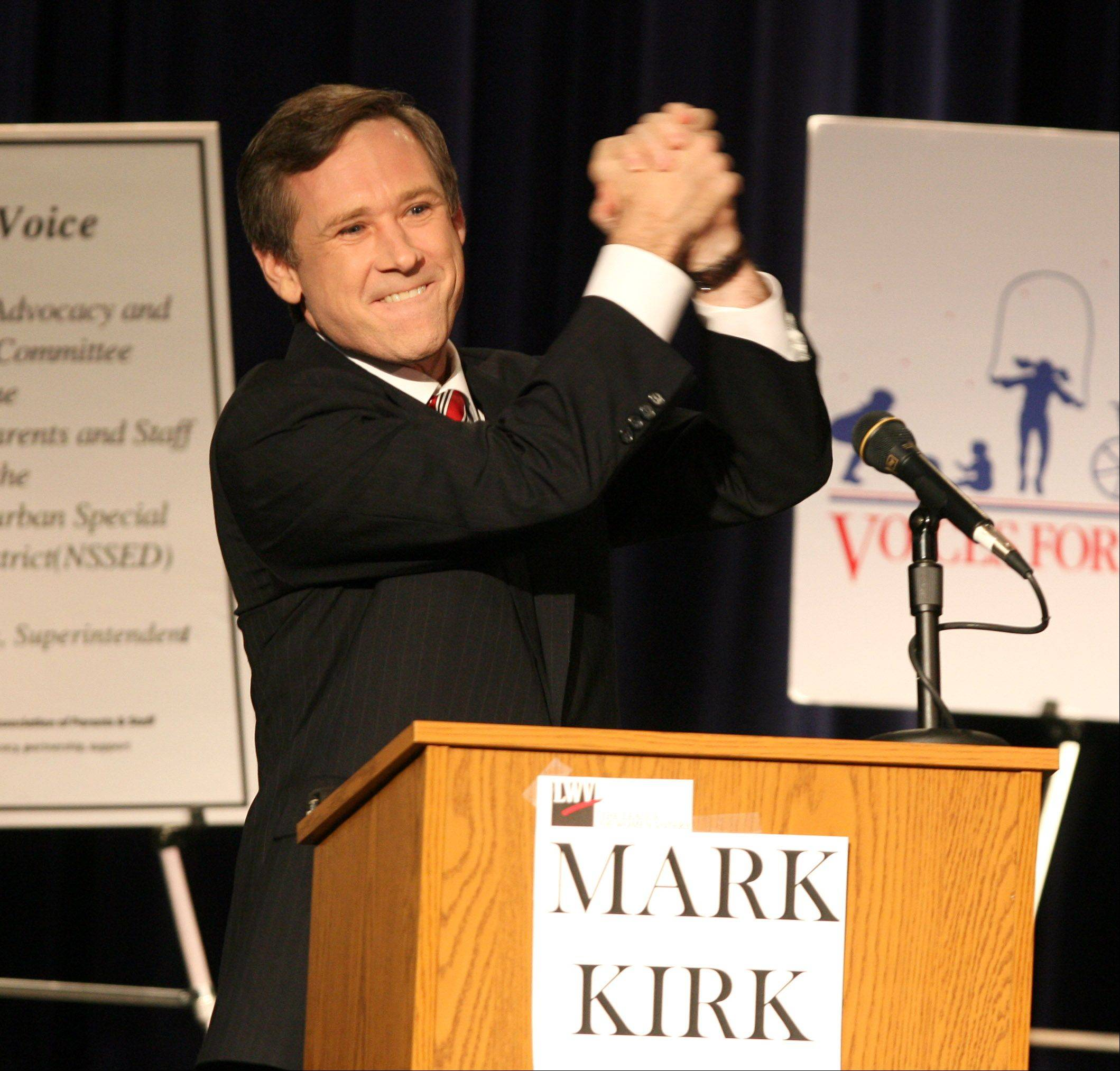 Then-Congressman Mark Kirk acknowledges the crowd at Stevenson High School debate in 2006.