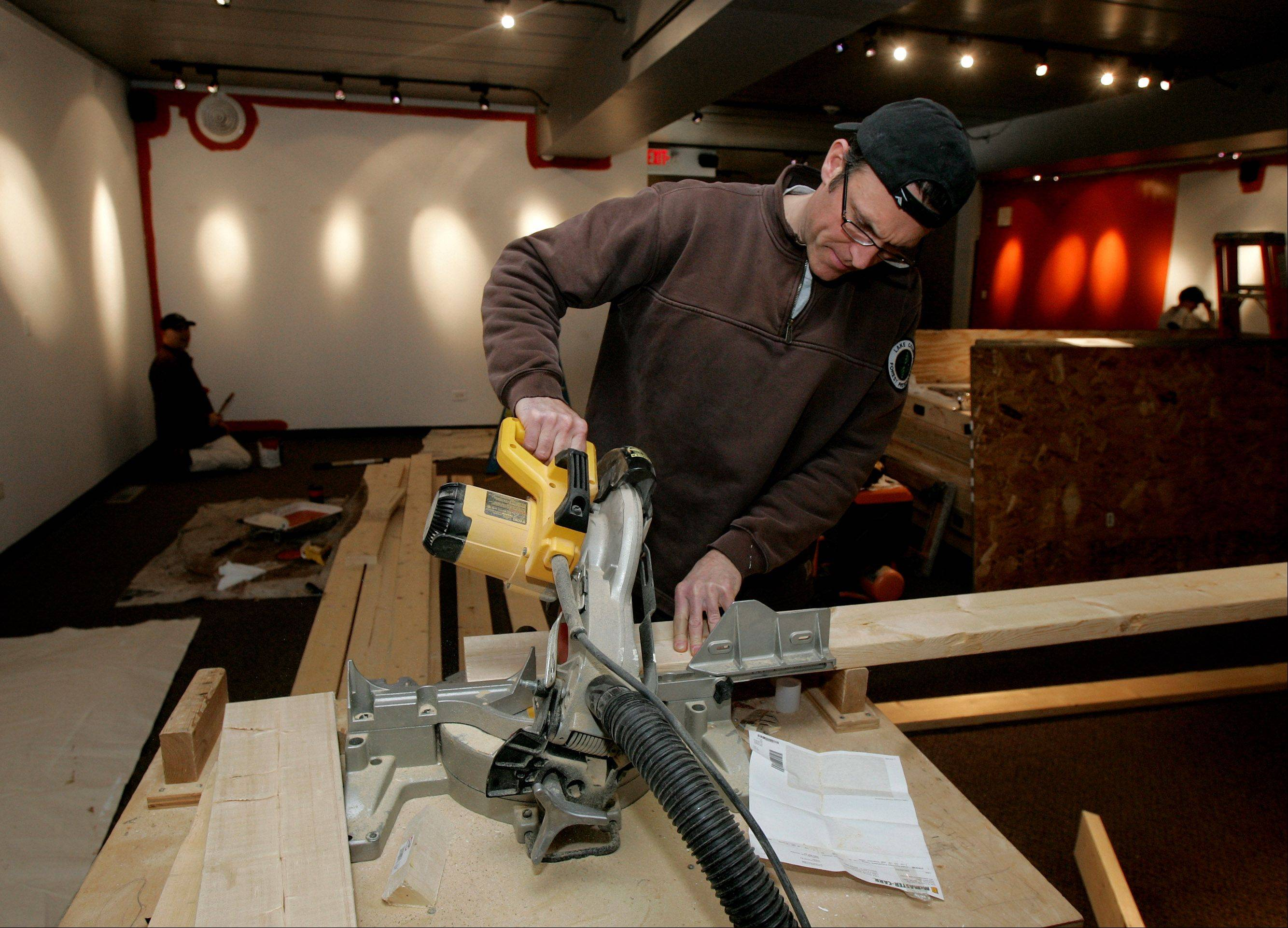 "Carpenter Jason Rundall works on the construction of the upcoming exhibit ""The Blues: From the Heart and Soul."""