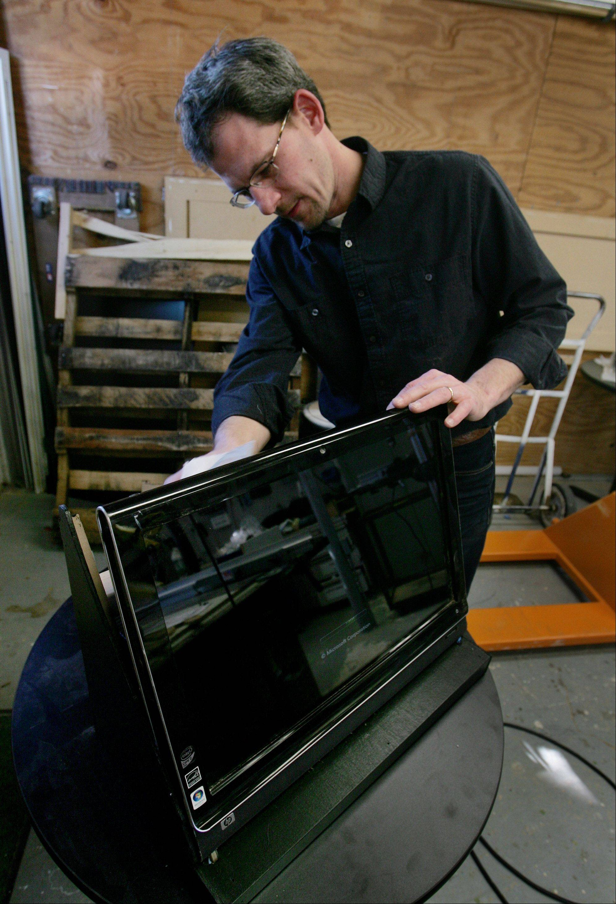 "Collections manager Steve Furnett works on a computer monitor to be used in the upcoming exhibit ""The Blues: From the Heart & Soul."""