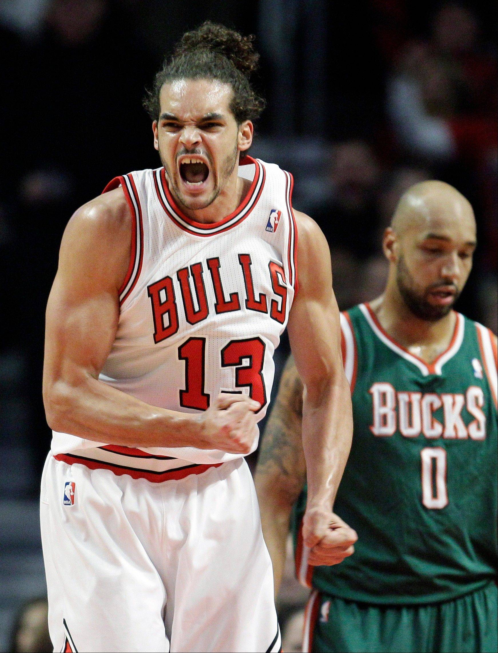 Bulls center Joakim Noah (13) reacts after scoring as Milwaukee Bucks forward Drew Gooden (0) looks away during the first quarter of an NBA basketball game in Chicago on Friday, Jan. 27, 2012.